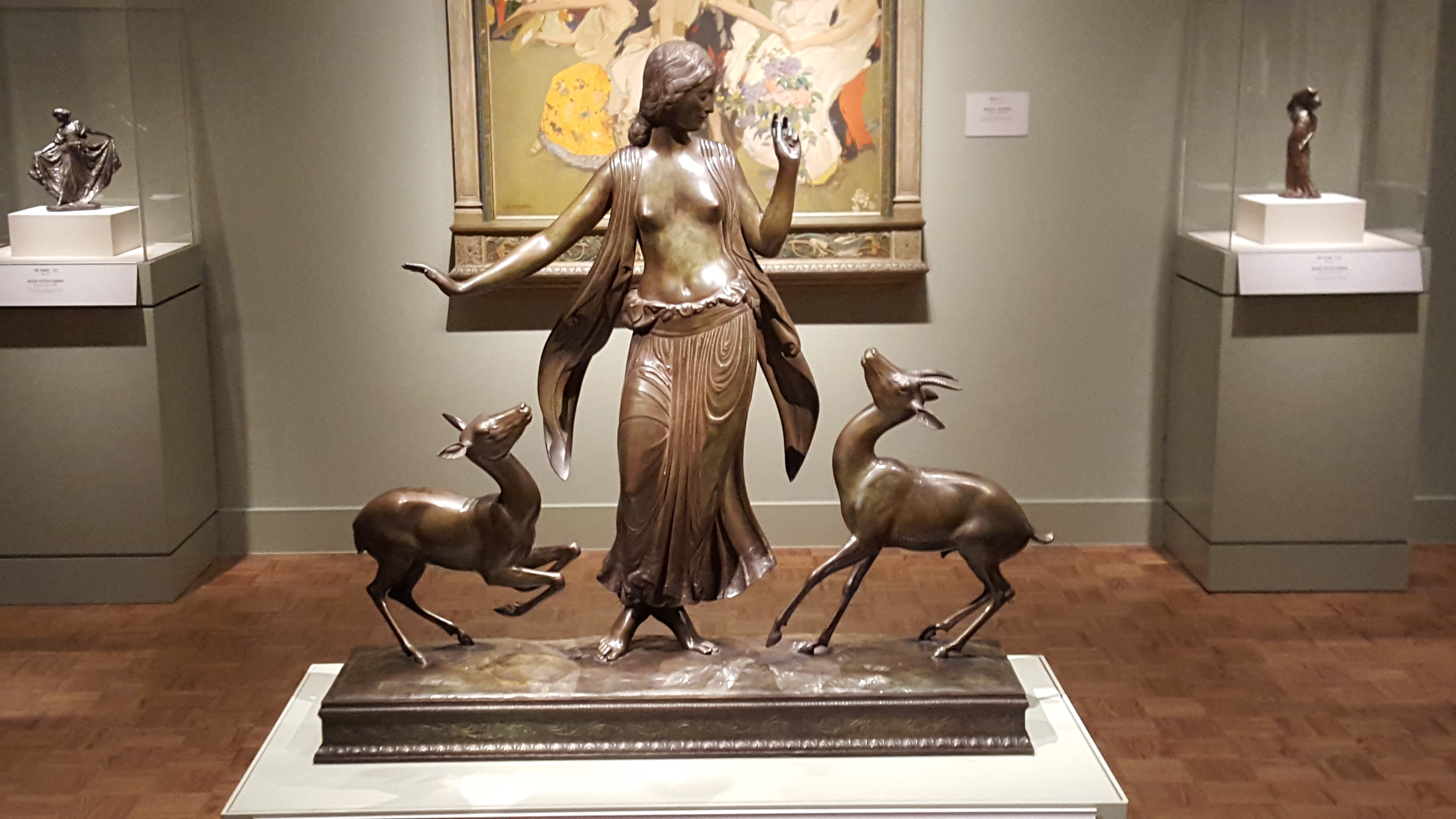 Statue of woman dancing with animals.