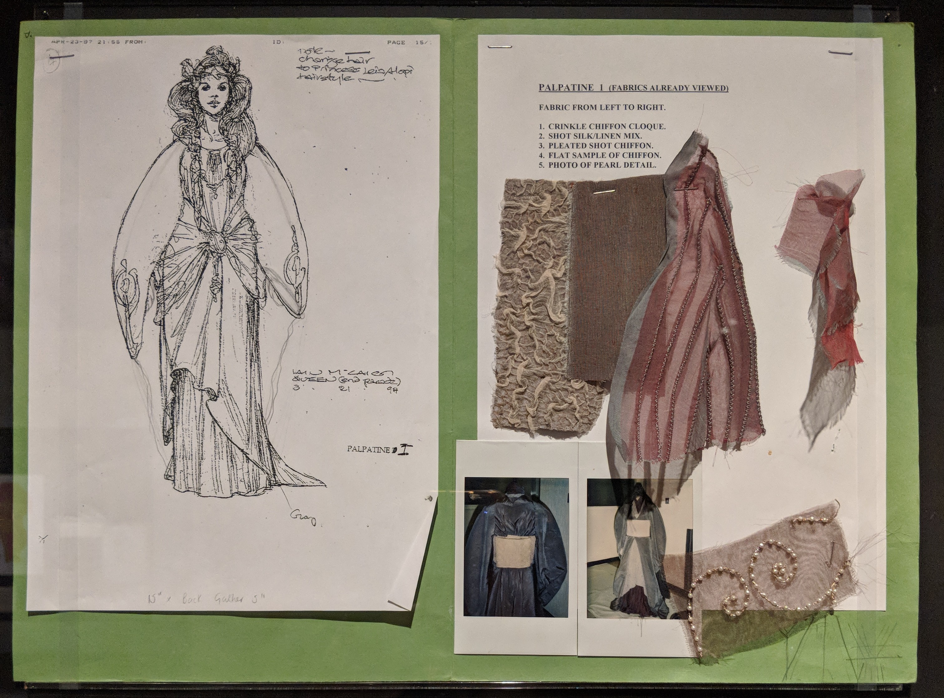 "Photo of ""Wardrobe Bible"" page showcasing finalized concept art and cloth threads"