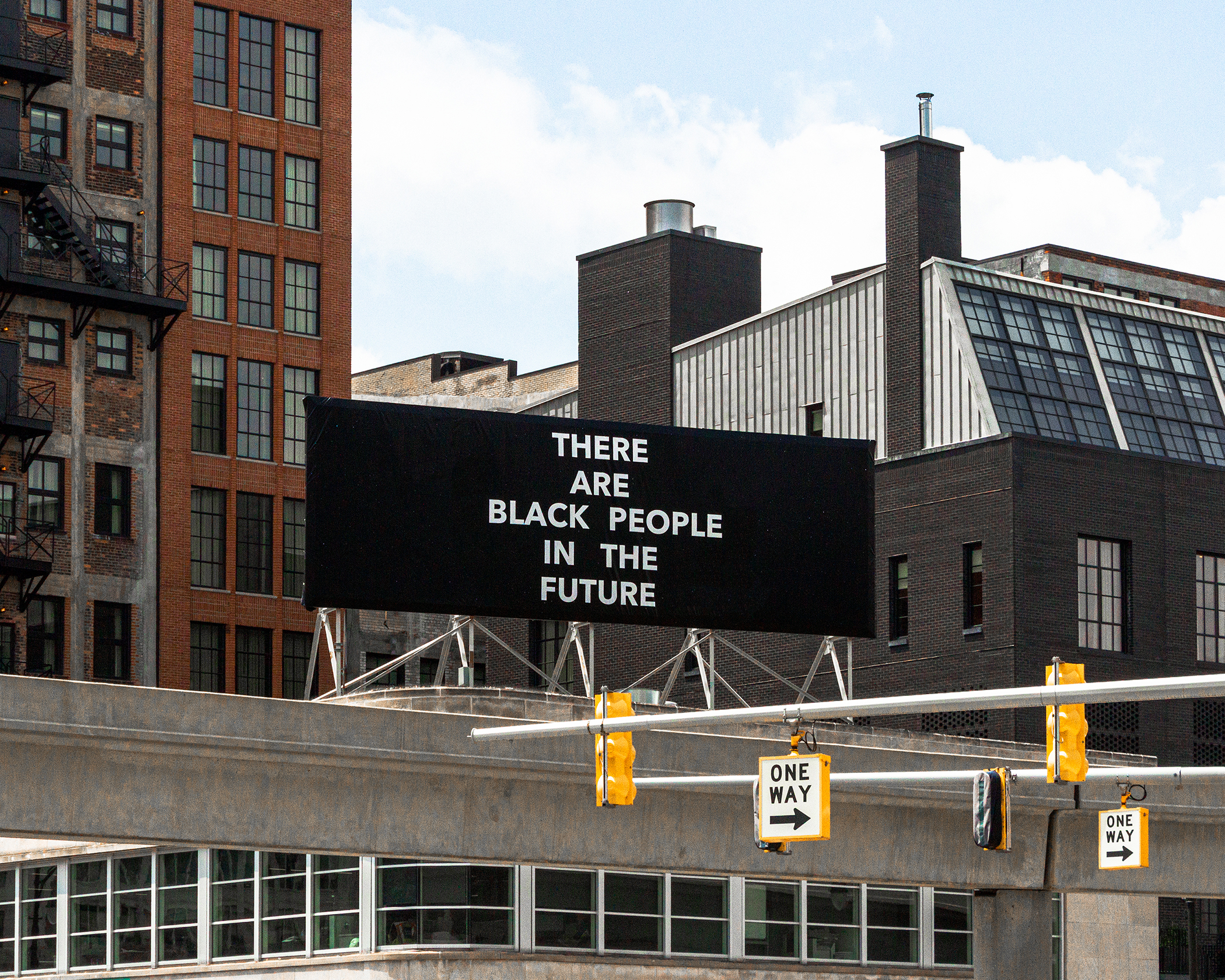 "Photo of a billboard reading ""There are black people in the future"""