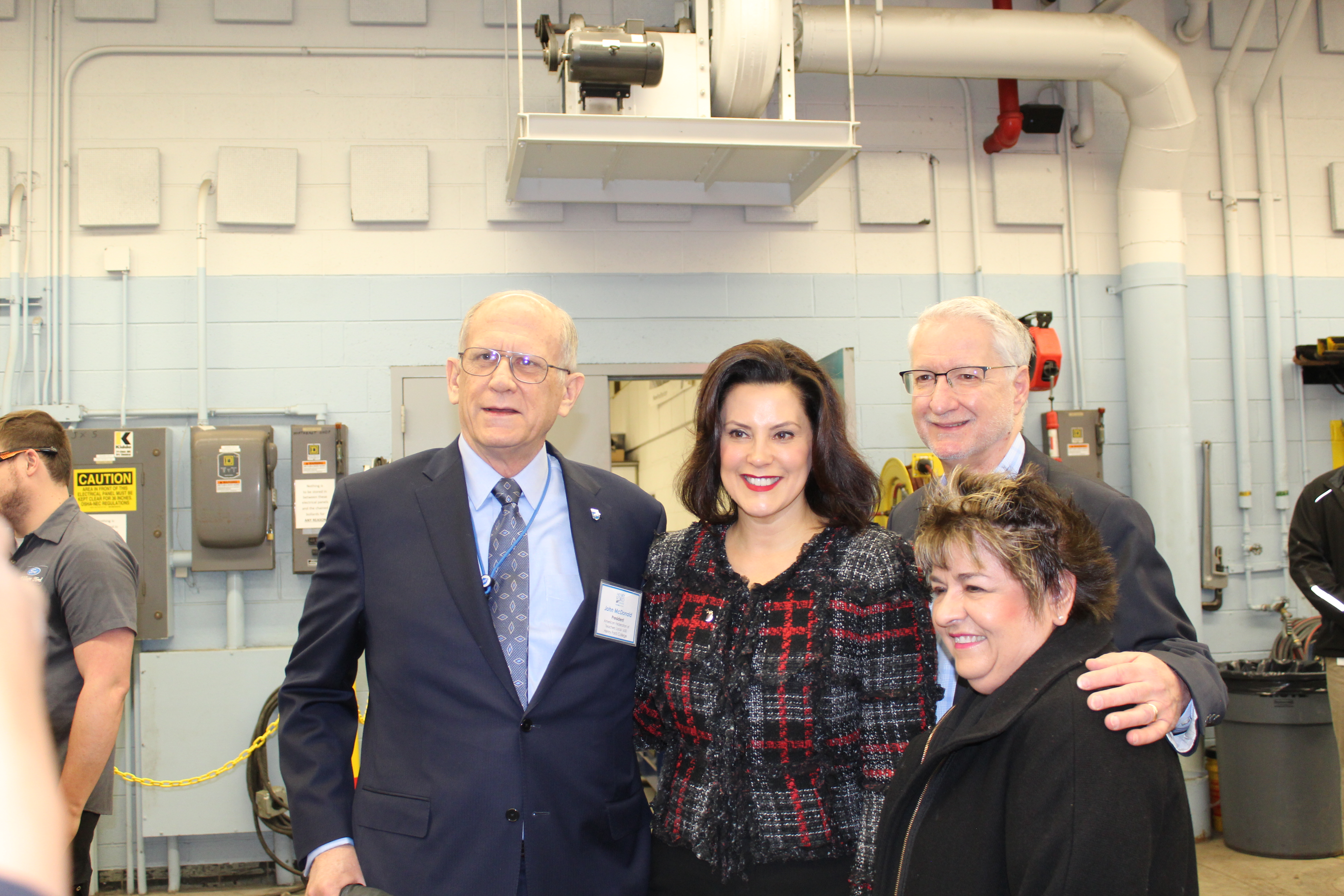 American Federation of Teachers Local 1650 President John MacDonald with Michigan Governor Gretchen Whitmer and two HFC community supporters