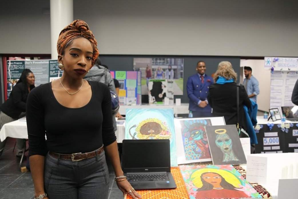Student in front of her Social Venture challenge display