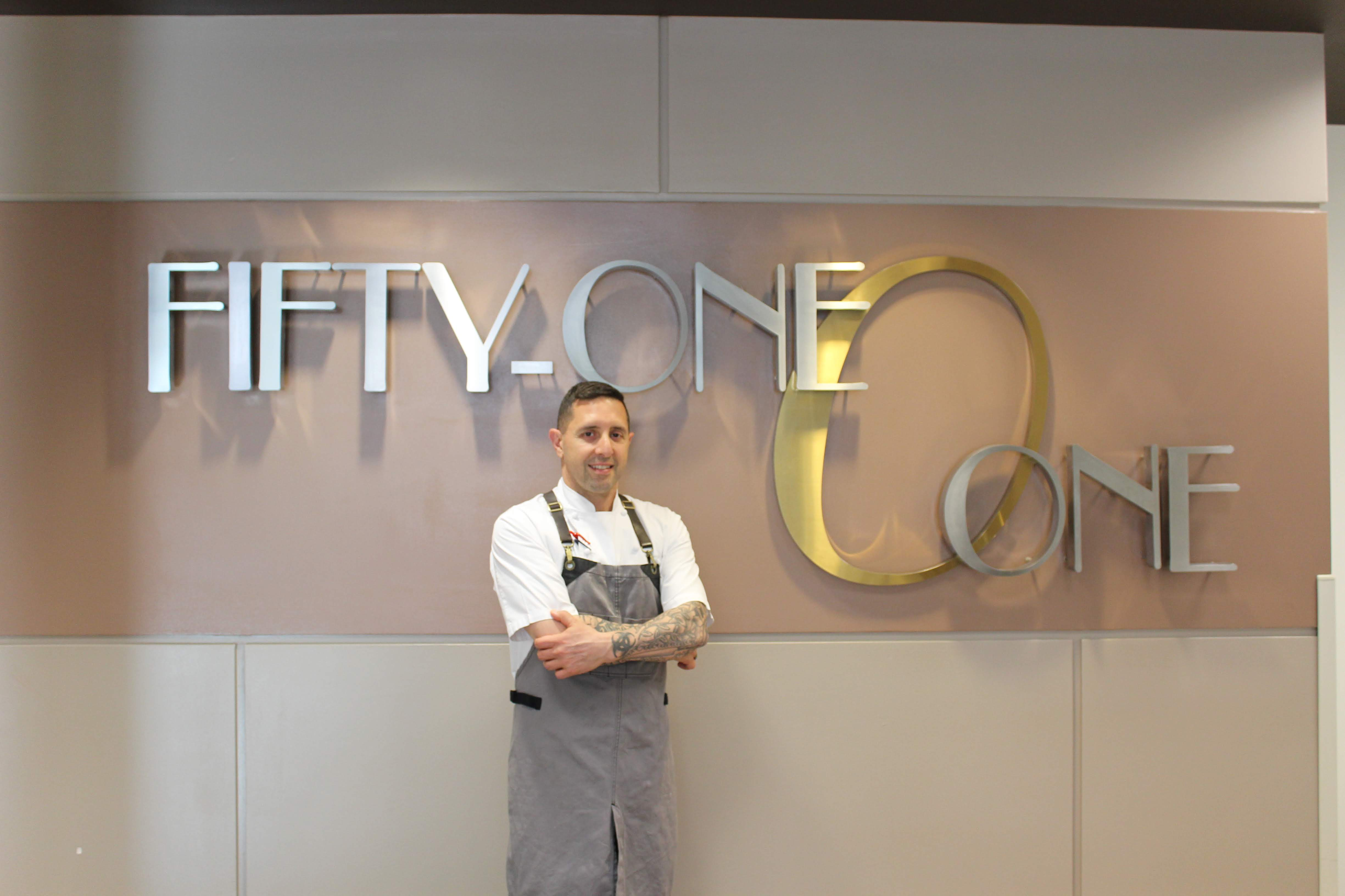 Chef Cosenza in front of the Fifty-One O One sign