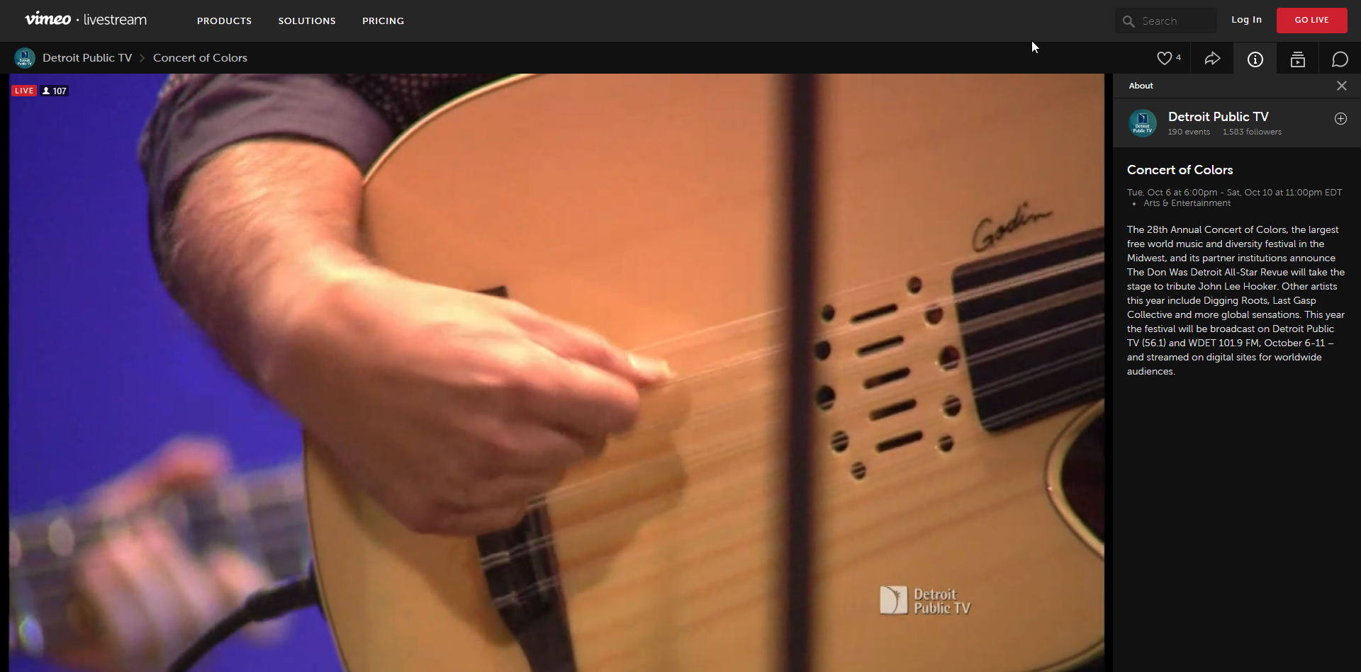 Close up of Sean Blackman strumming guitar, Concert of Colors on PBS Oct. 8, 2020
