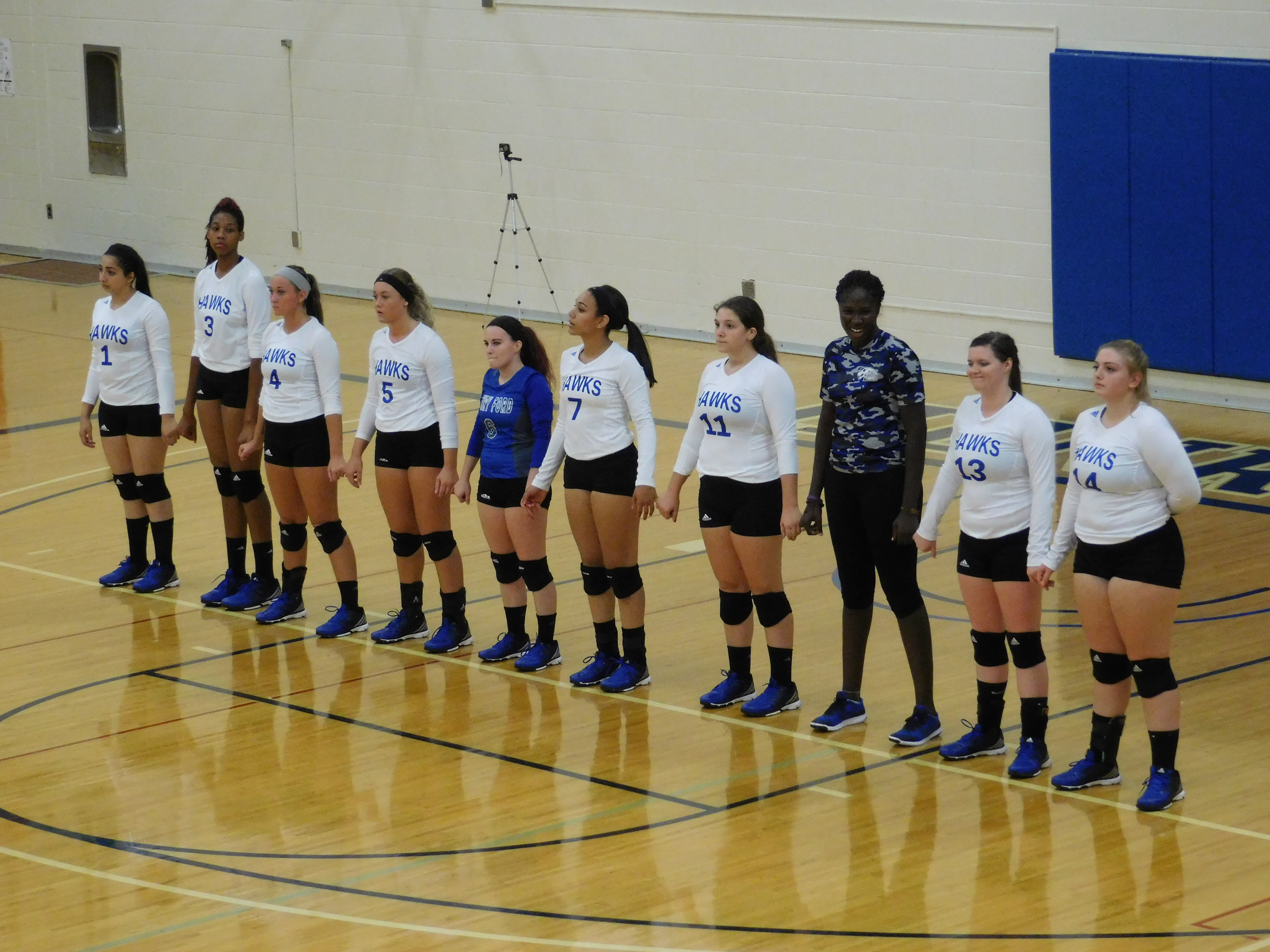 Hawks girls volleyball team lined up before the game.