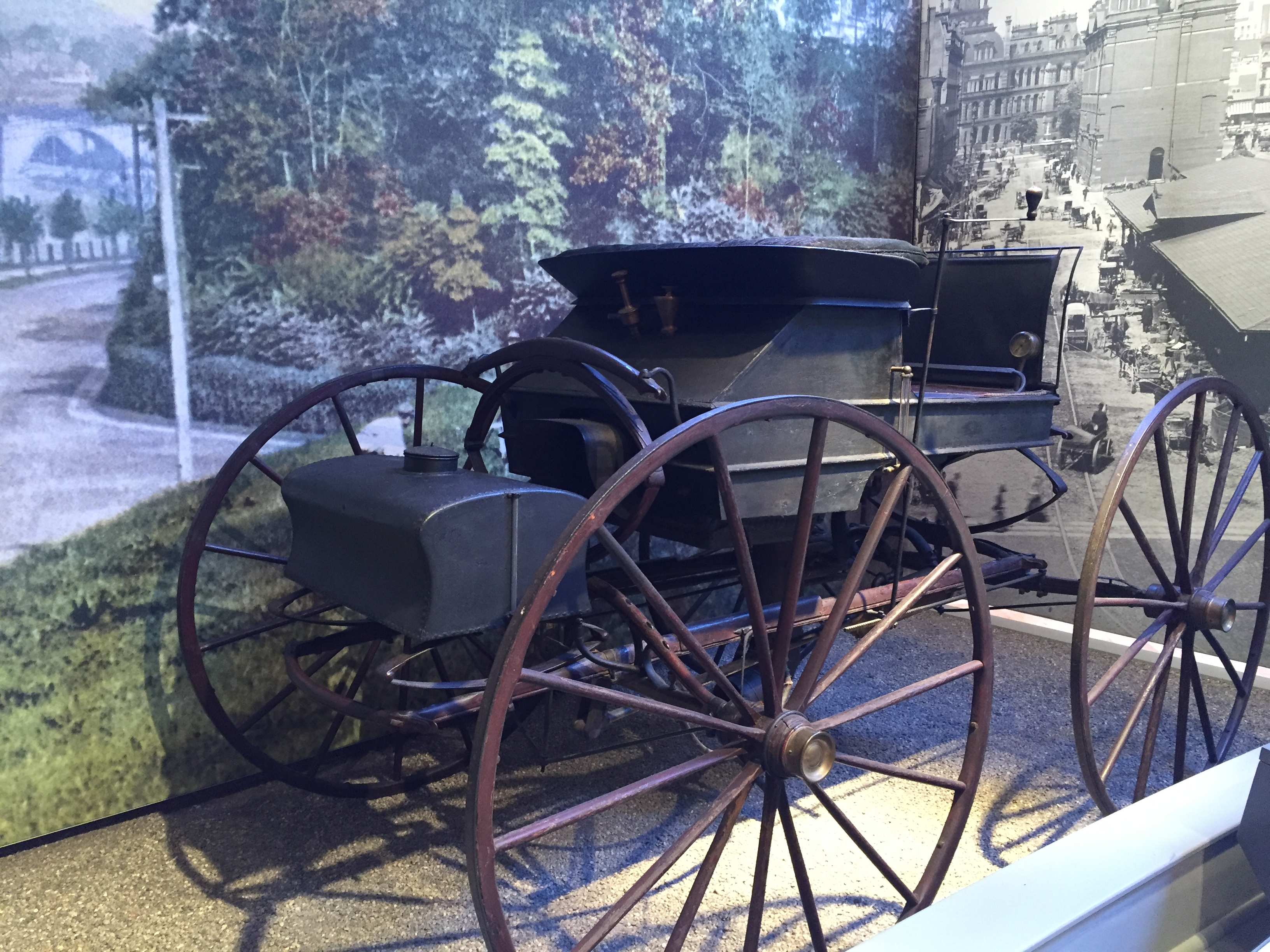 An early version of a car that looks like a carriage with a motor.