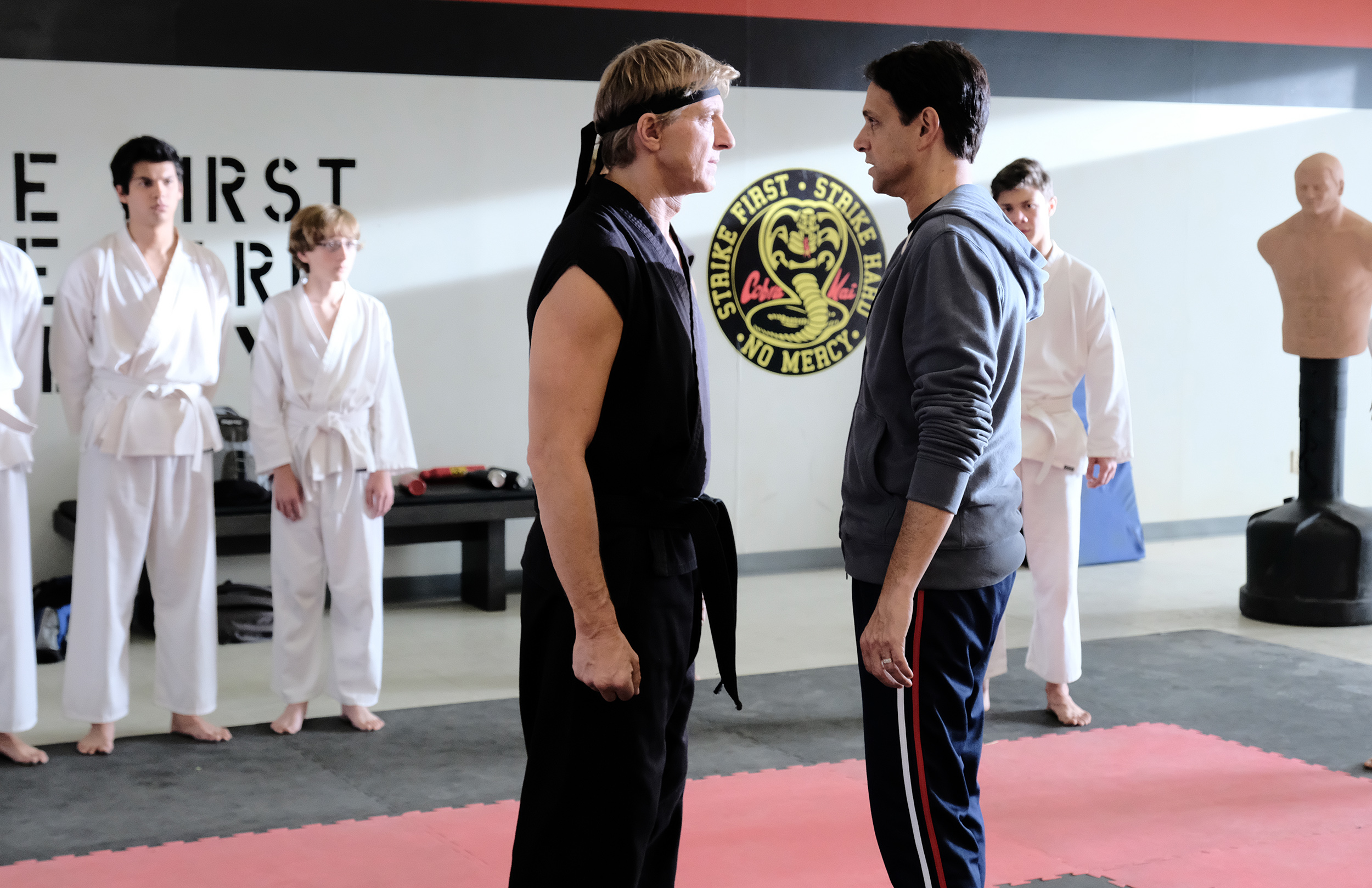 "William Zabka as Johnny Lawrence faces off against Ralph Macchio as Daniel LaRusso in ""Cobra Kai"""