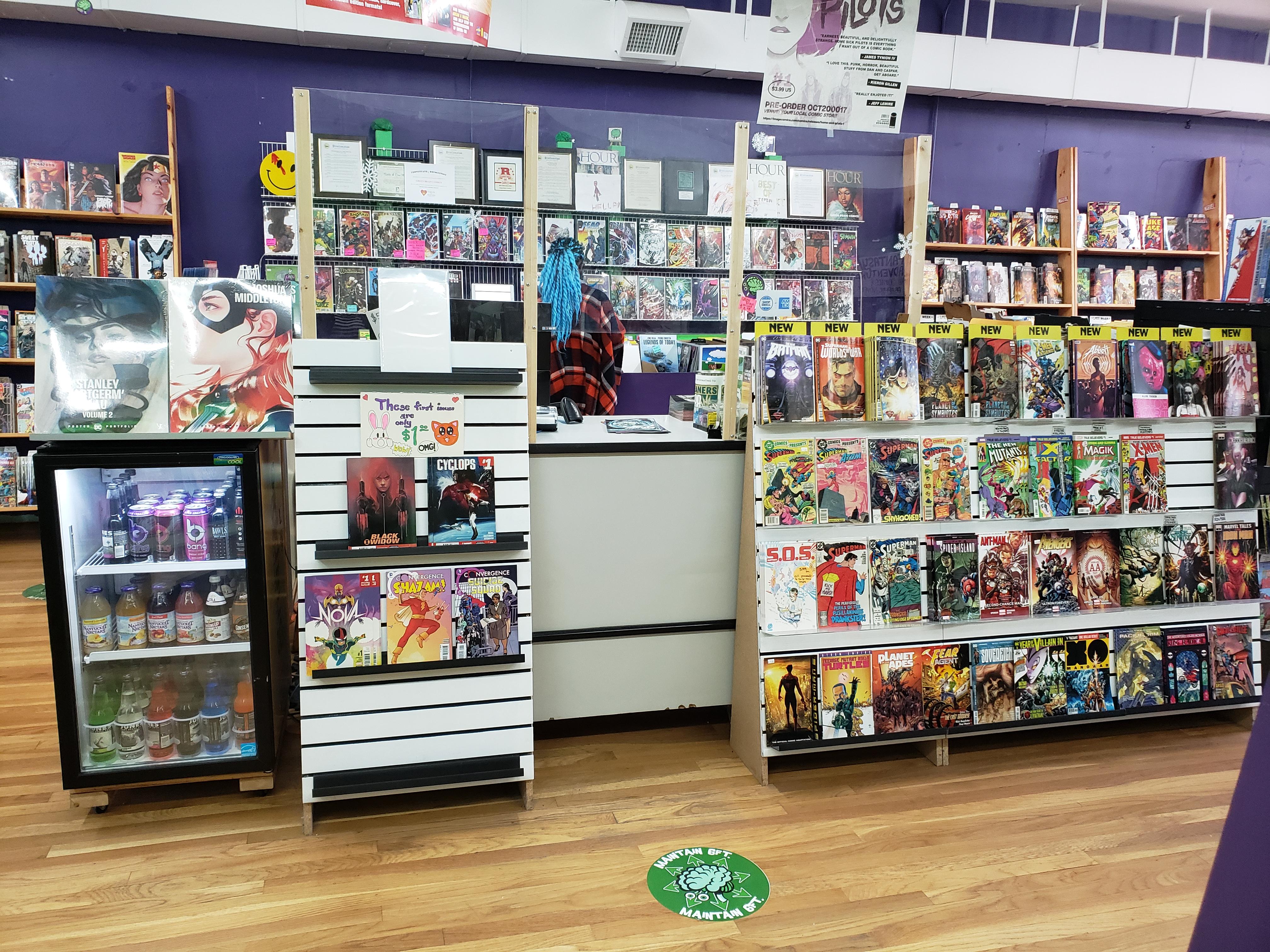 Plexiglass installed at Green Brain Comics, Dearborn, Michigan