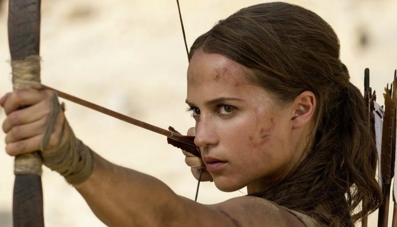 "Alicia Vikander as Lara Croft in ""Tomb-Raider"" holding a bow and arrow"
