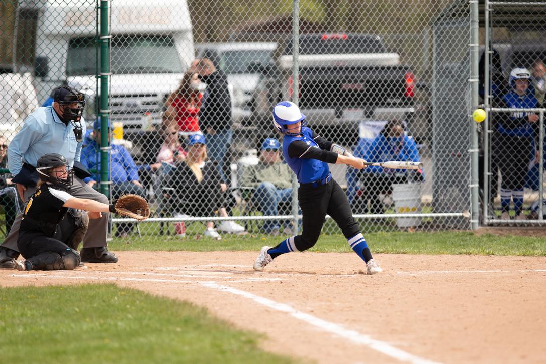 Hawks softball player Haley Zimmerman hitting ball during a game