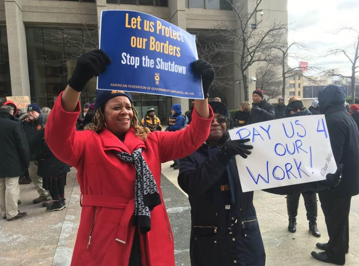 Federal workers and their supporters protest the ongoing partial government shutdown in Detroit.