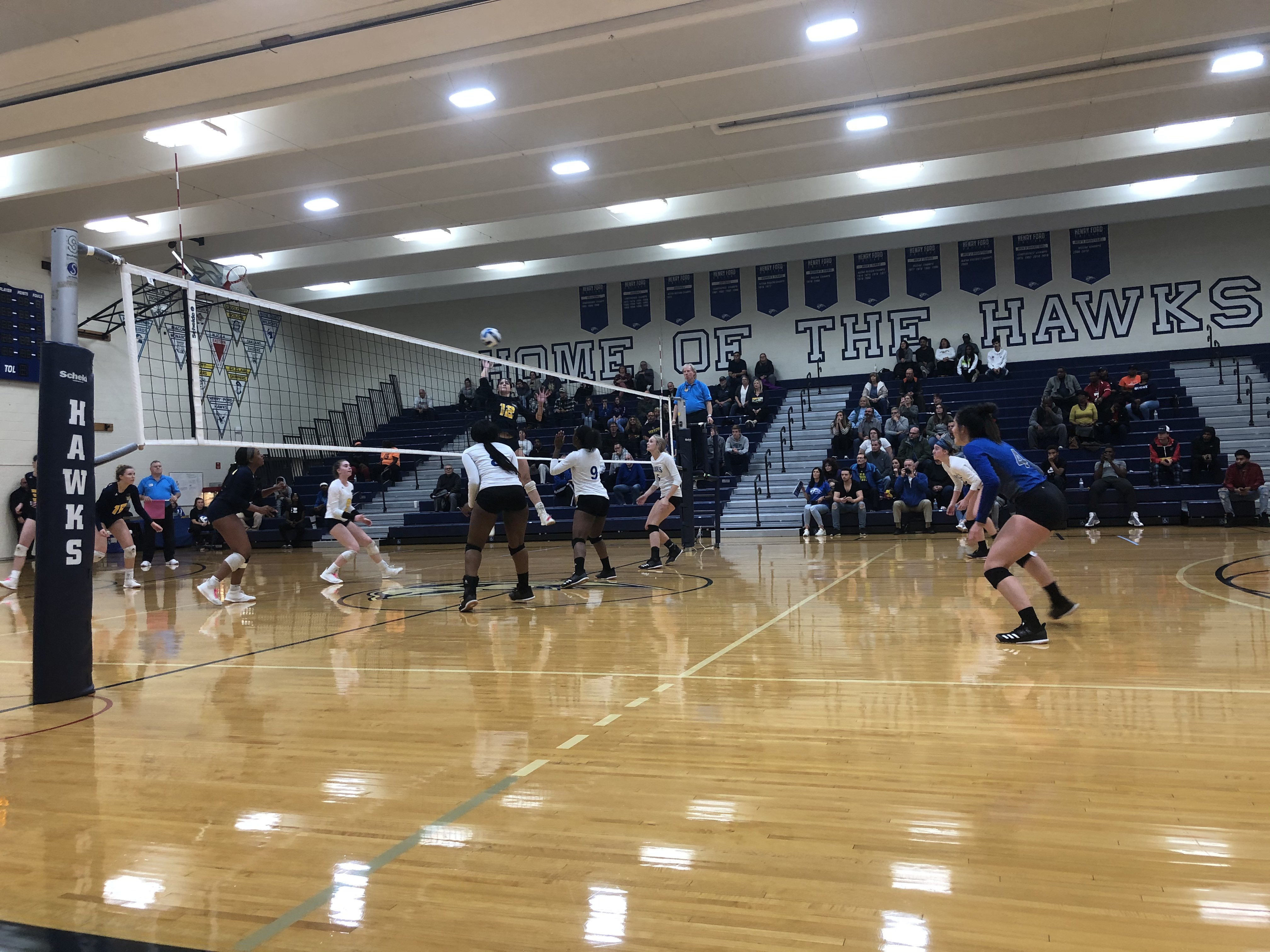 Photo shows volleyball game between HFC Lady Hawks and Saint Clair Community College