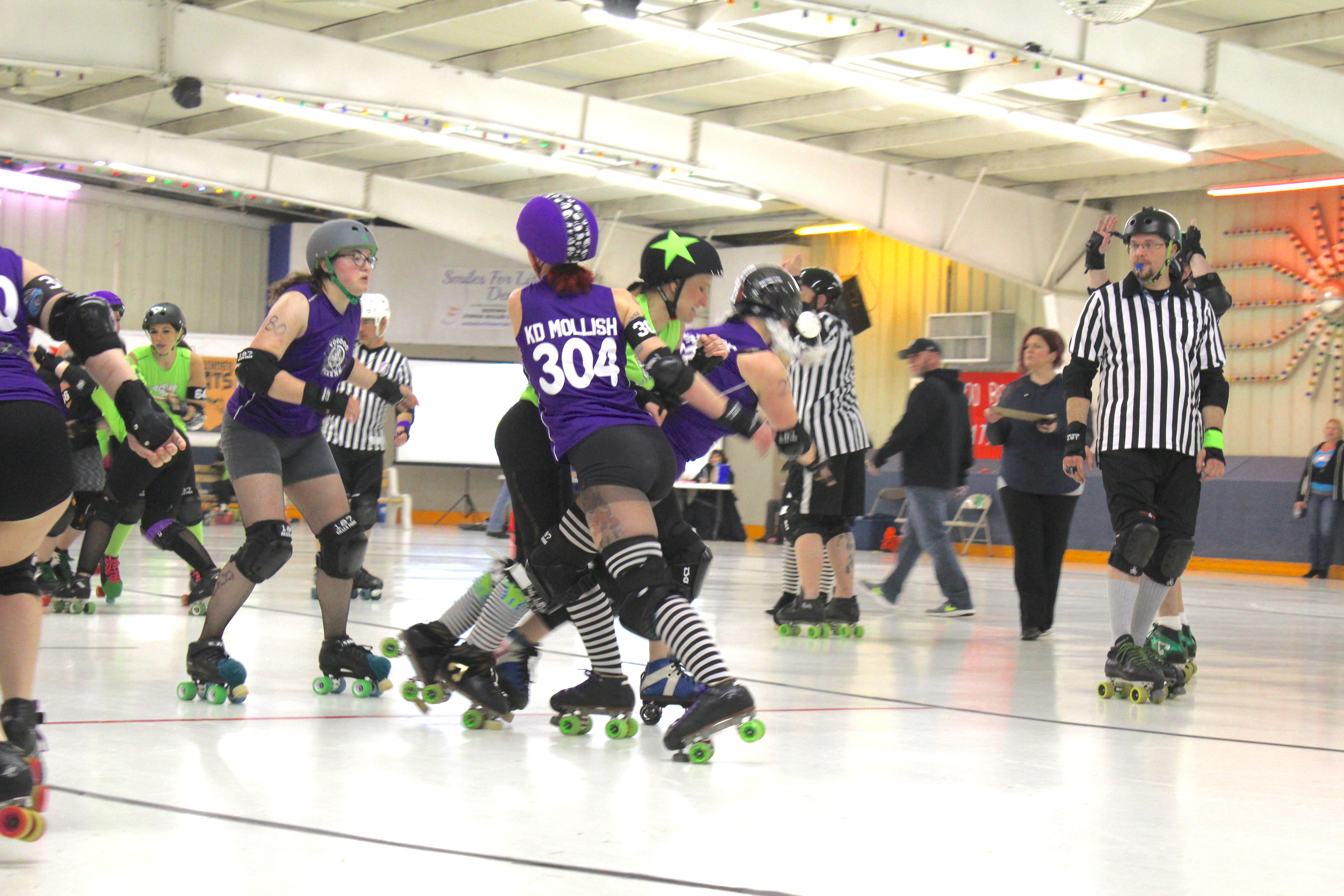 Women playing in a roller derby game.