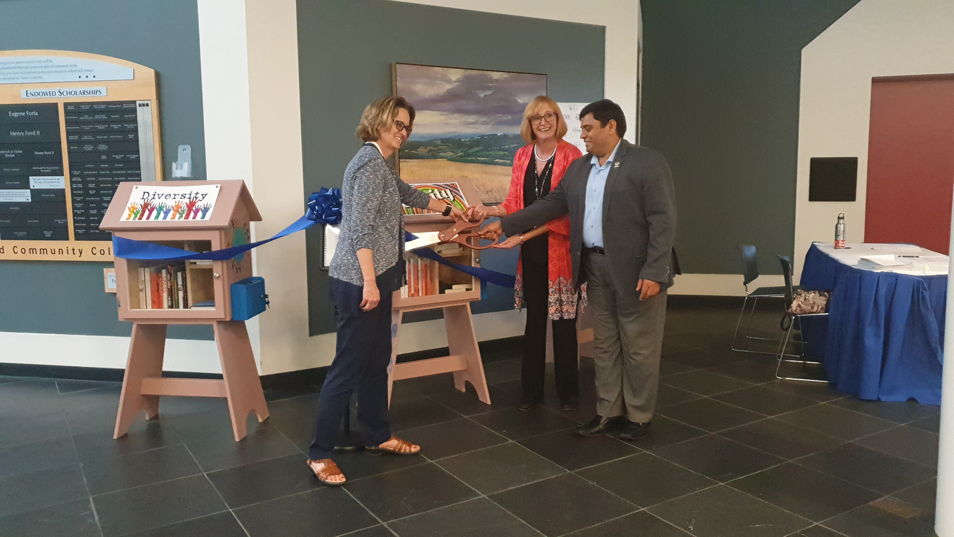 Image shows Katherine Snyder, Ashok Kumar and Janice Gililand at the Little Library's ribbon cutting