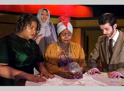 From left to right: Kennedy Cooper as Ruth, Natasha Hawkins as Elvira, Durshara Kirby as Madame Arcati, and Jesse Mattox as Charles.