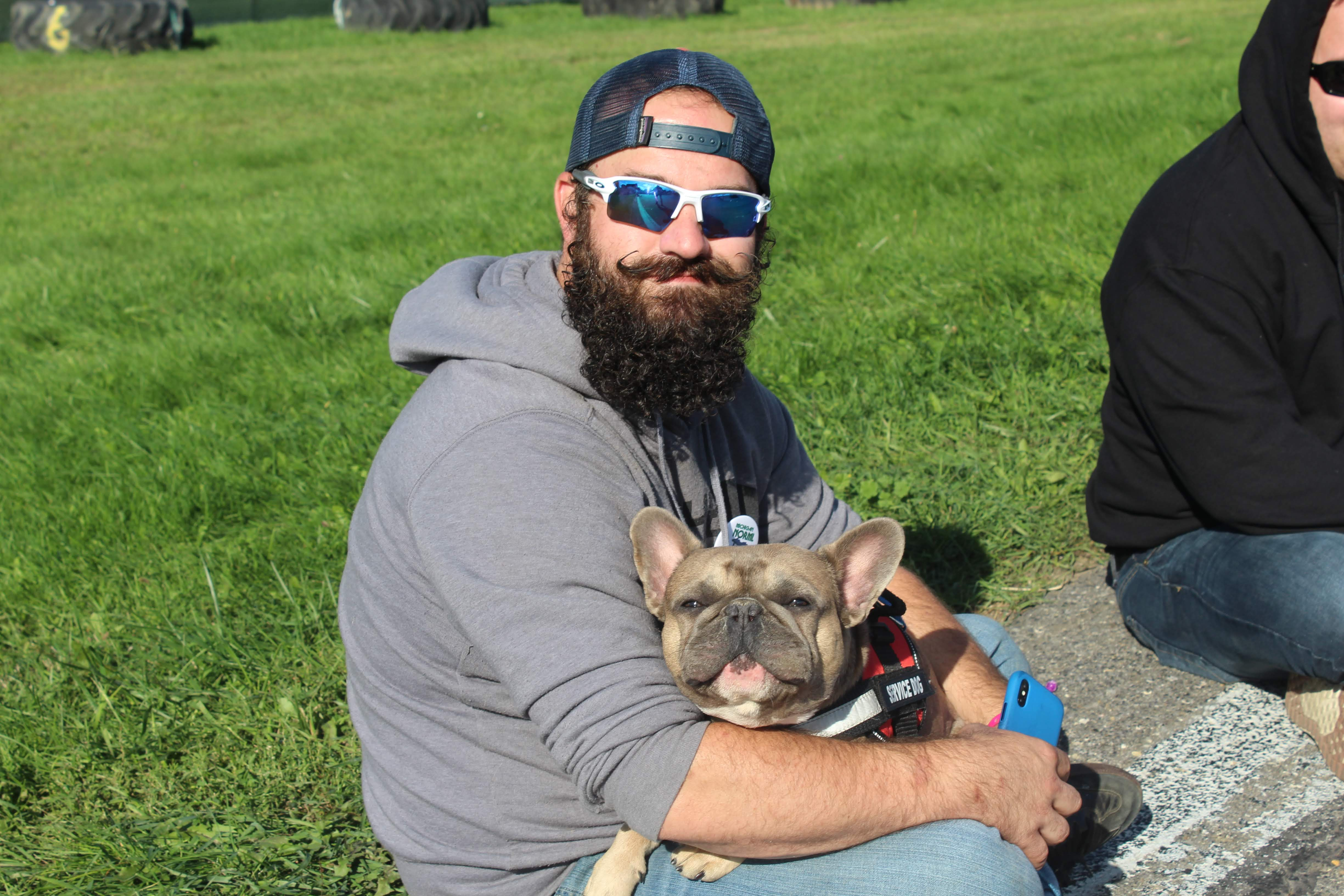 Photo of Cannabis Cup attendee Levi with his French Bulldog, Kermit