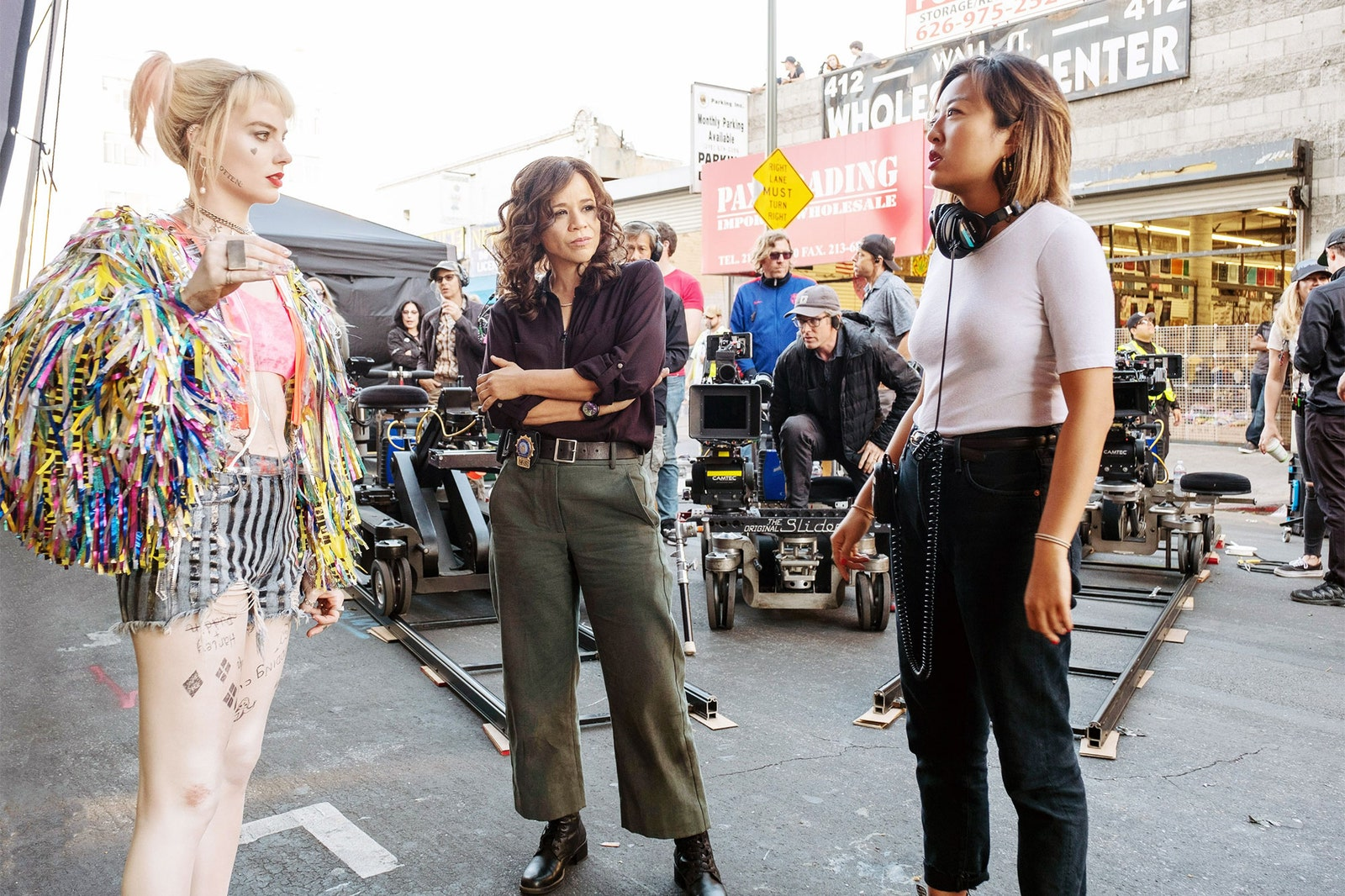 "Image shows Margot Robbie, Rosie Perez and Cathy Yan on the set of ""Birds of Prey"""
