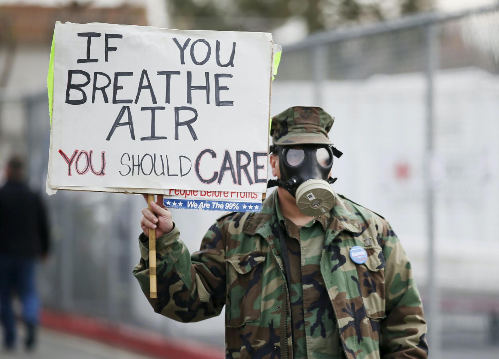Photo of protestor at Aliso Canyon natural gas storage facility October 2015. Photo courtesy AP.