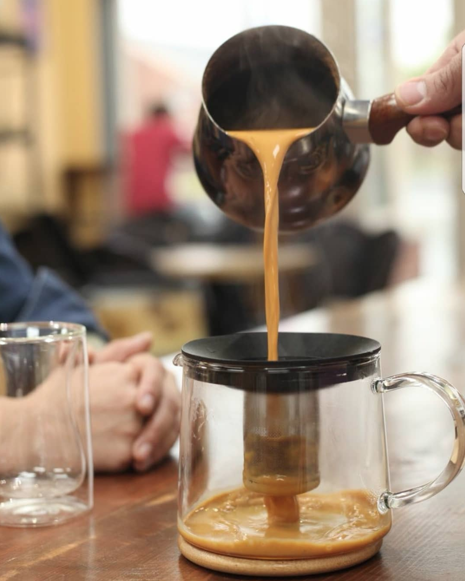 Photo of coffee being poured from Qahwah House