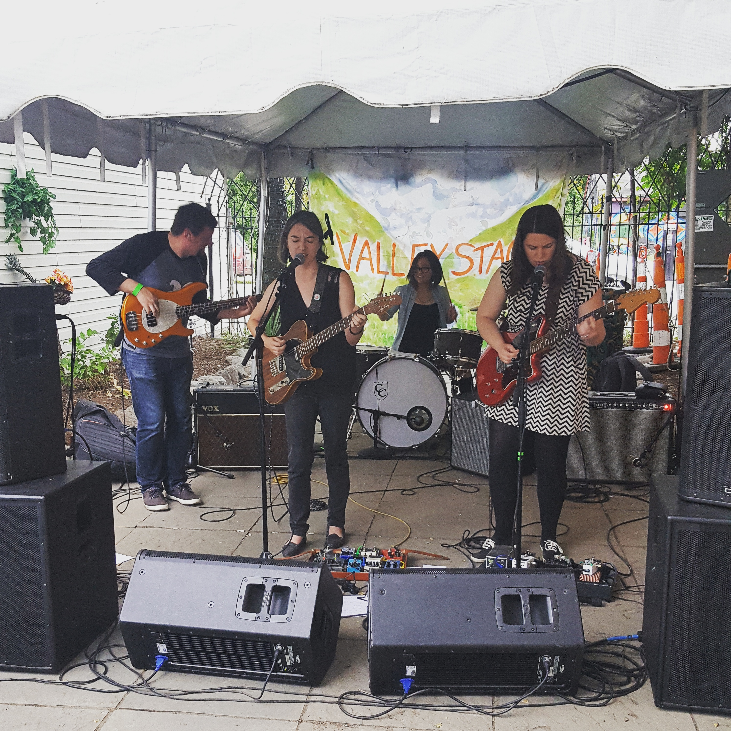 "Three musicians playing the guitar for Seraphine Collective ""Child Sleep"" at BFF Fest 4"