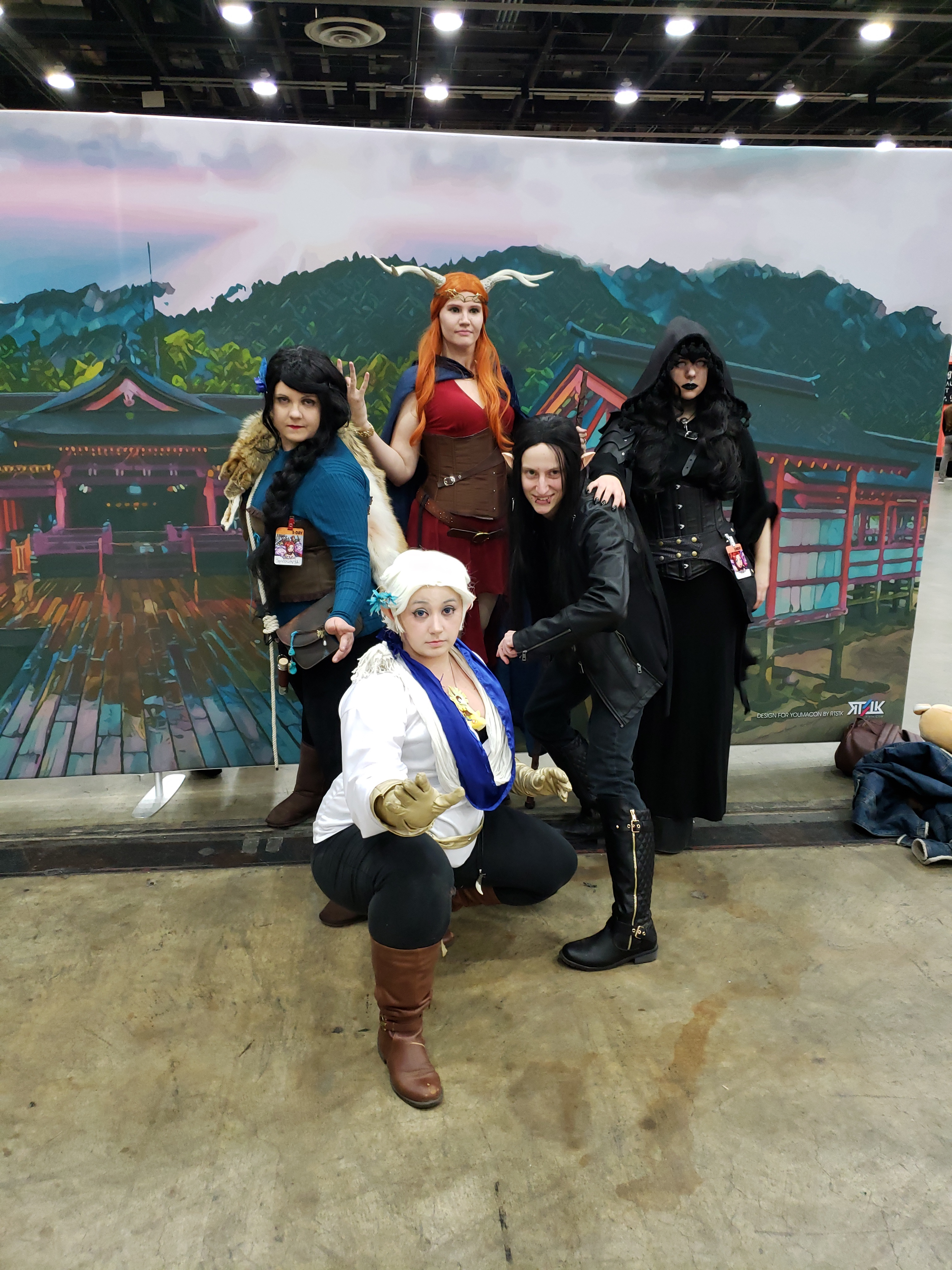 Three people cosplaying as various characters