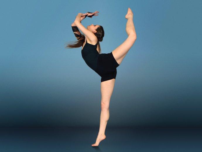 Sylvia Suttle, former HFC dancer in leotard in elegant ballet pose.