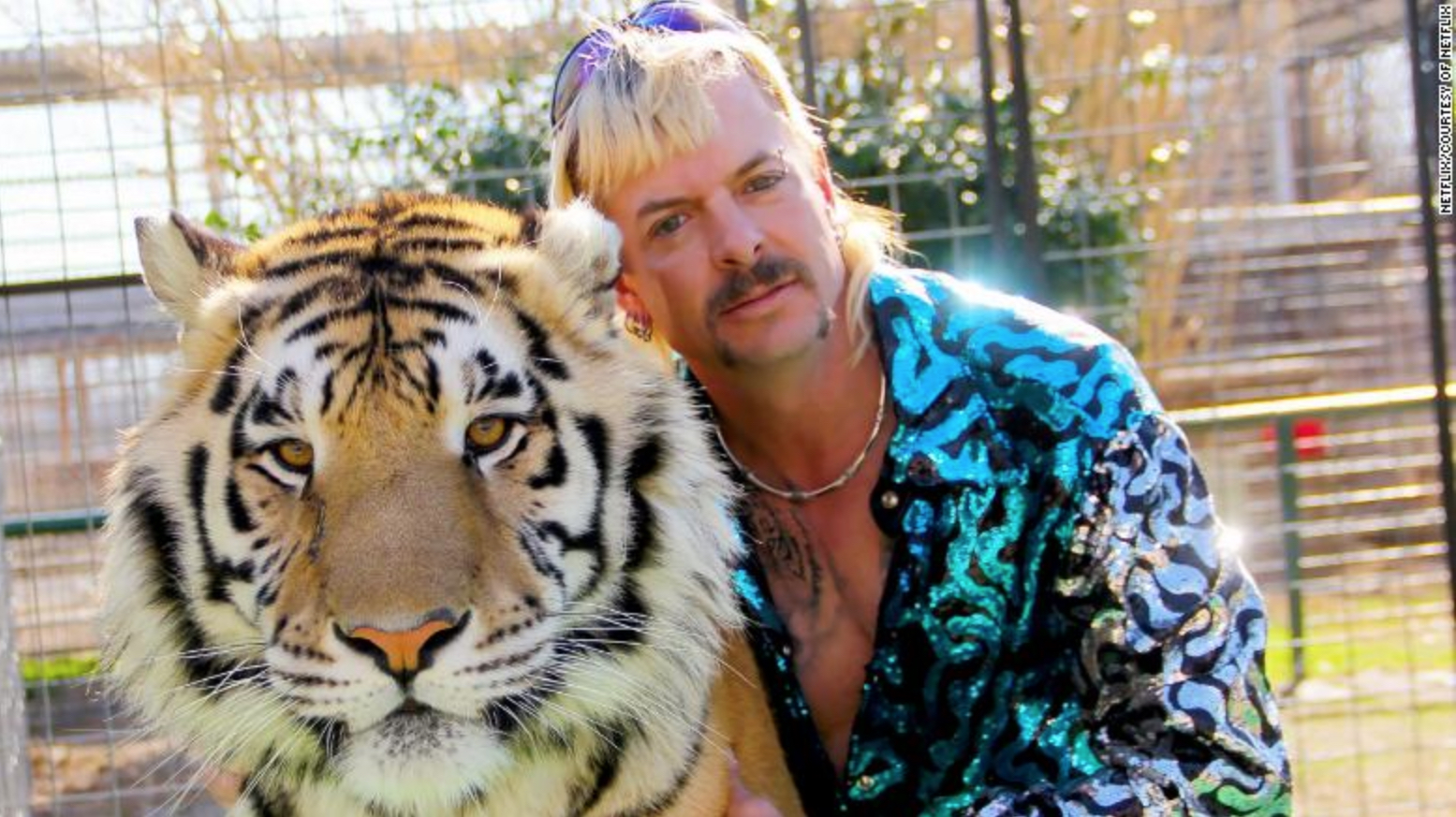 "Image shows Joe Exotic of ""Tiger King"" with a tiger"