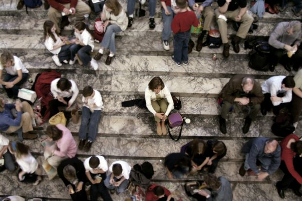 Graphic showing a woman sitting by herself while surrounded by people