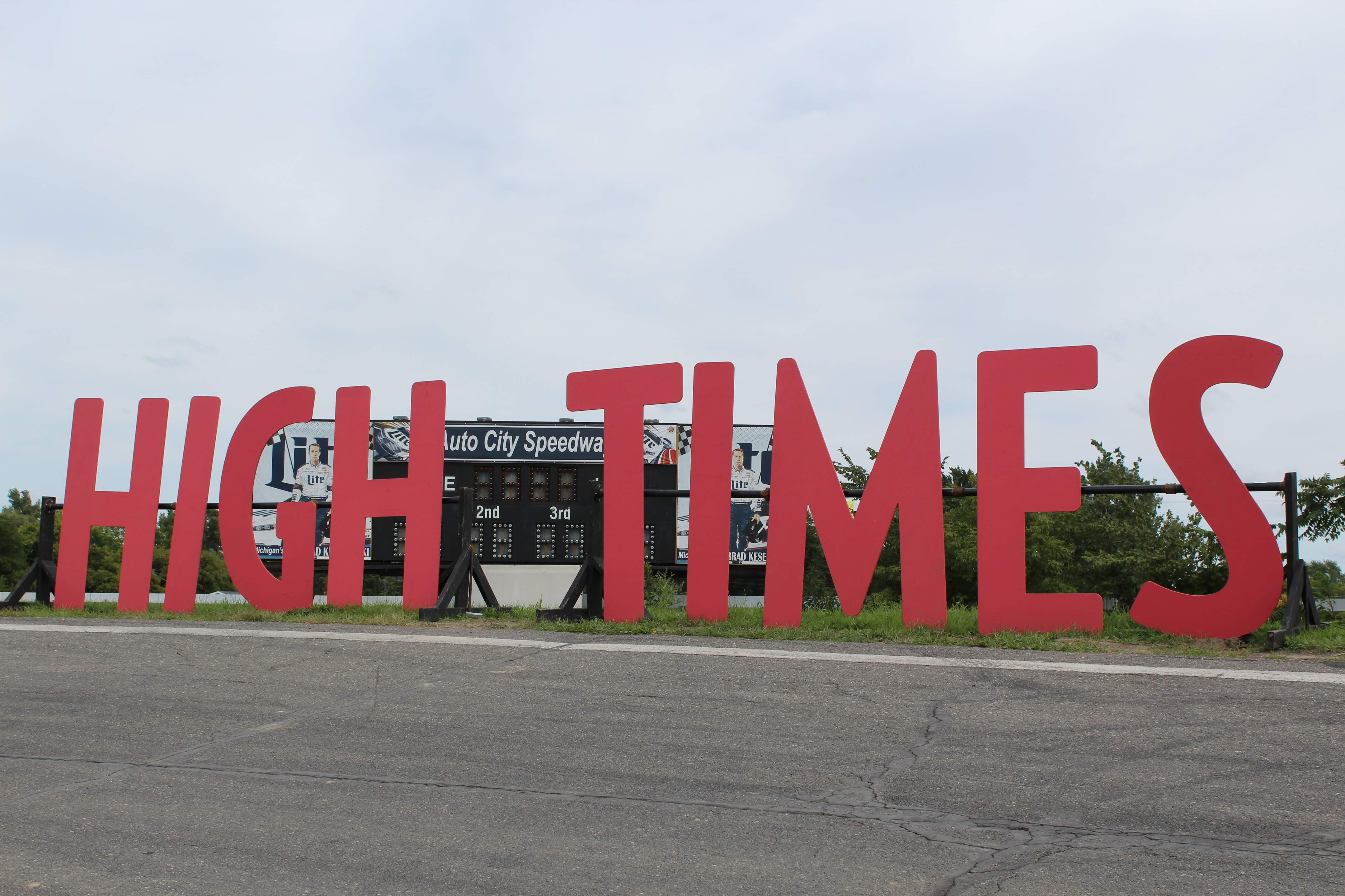 "Photo of a large sign at the Cannabis Cup which reads, ""High Times"""