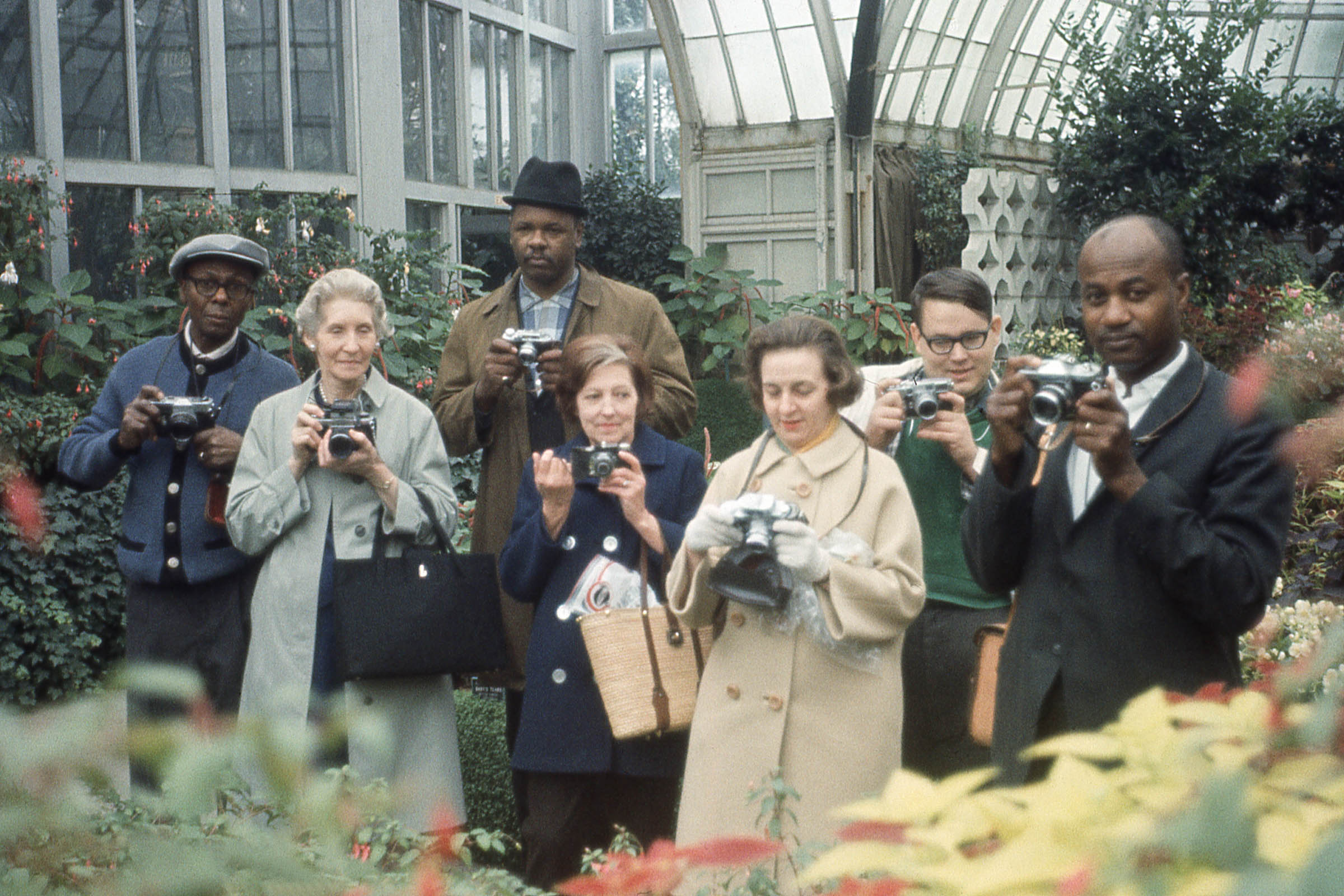 Group portrait with cameras at Belle Isle Conservatory, Detroit, around 1970. Attributed to Arthur Stross. Courtesy DIA.