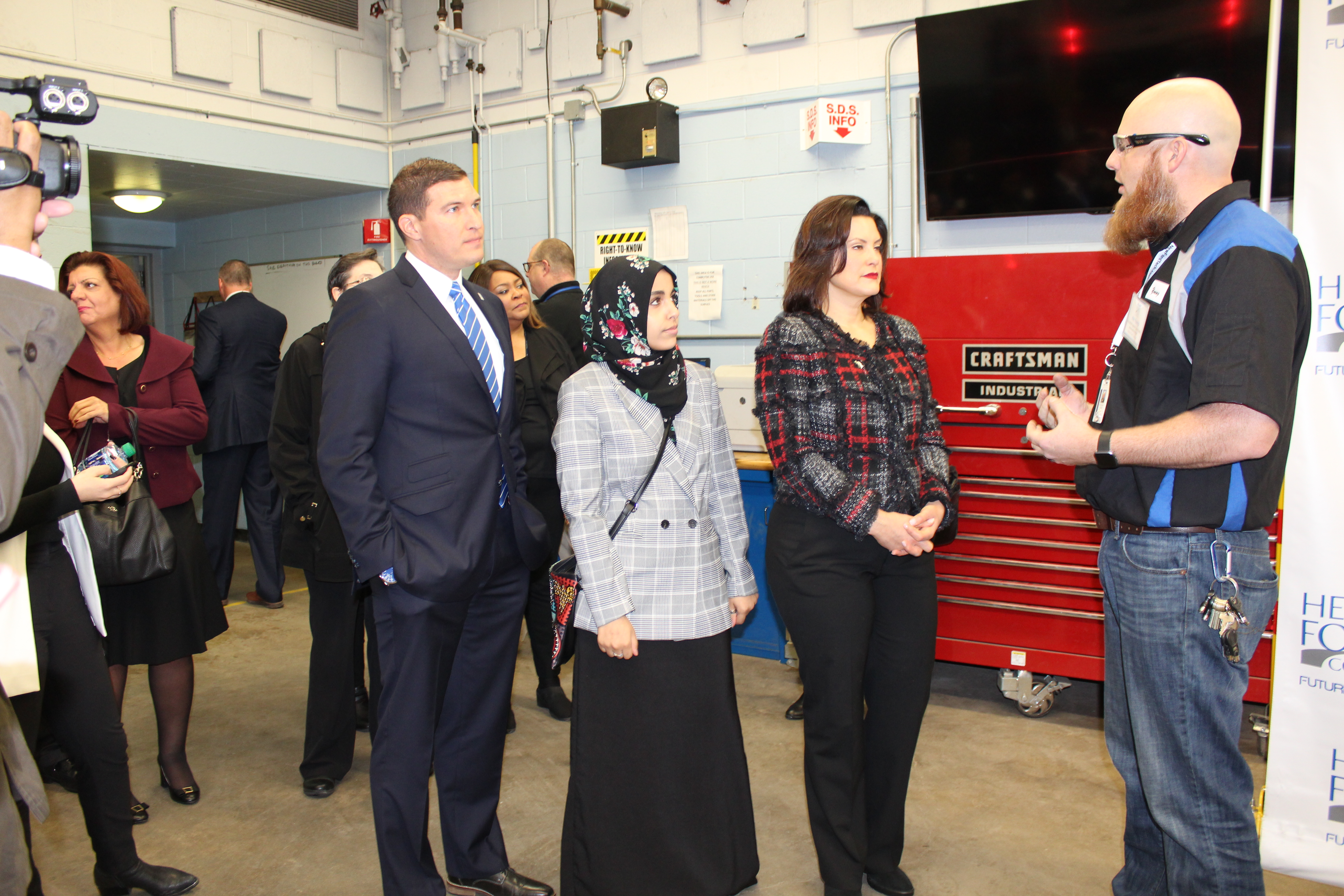 Henry Ford College President Russell Kavalhuna (left), HFC Student Council member Baraka Elmadari (middle), and Michigan Governor Gretchen Whitmer (left) at the automotive lab at Henry Ford College, Dearborn, MI, March 14, 2019. Photo by Fatima Nkata