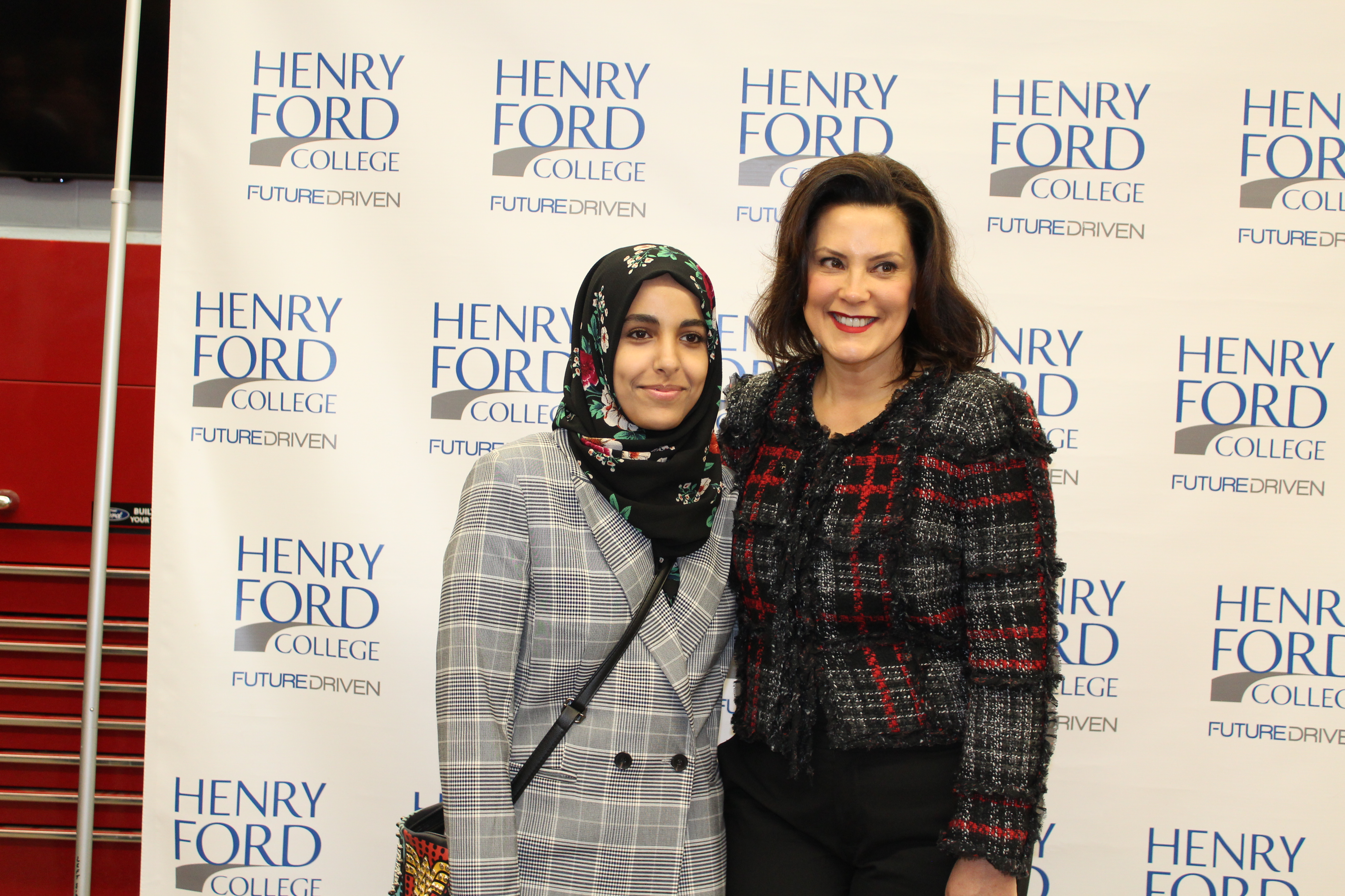 HFC Student Council member Baraka Elmadari (left) with Gov. Whitmer photo by Fatima Nkata