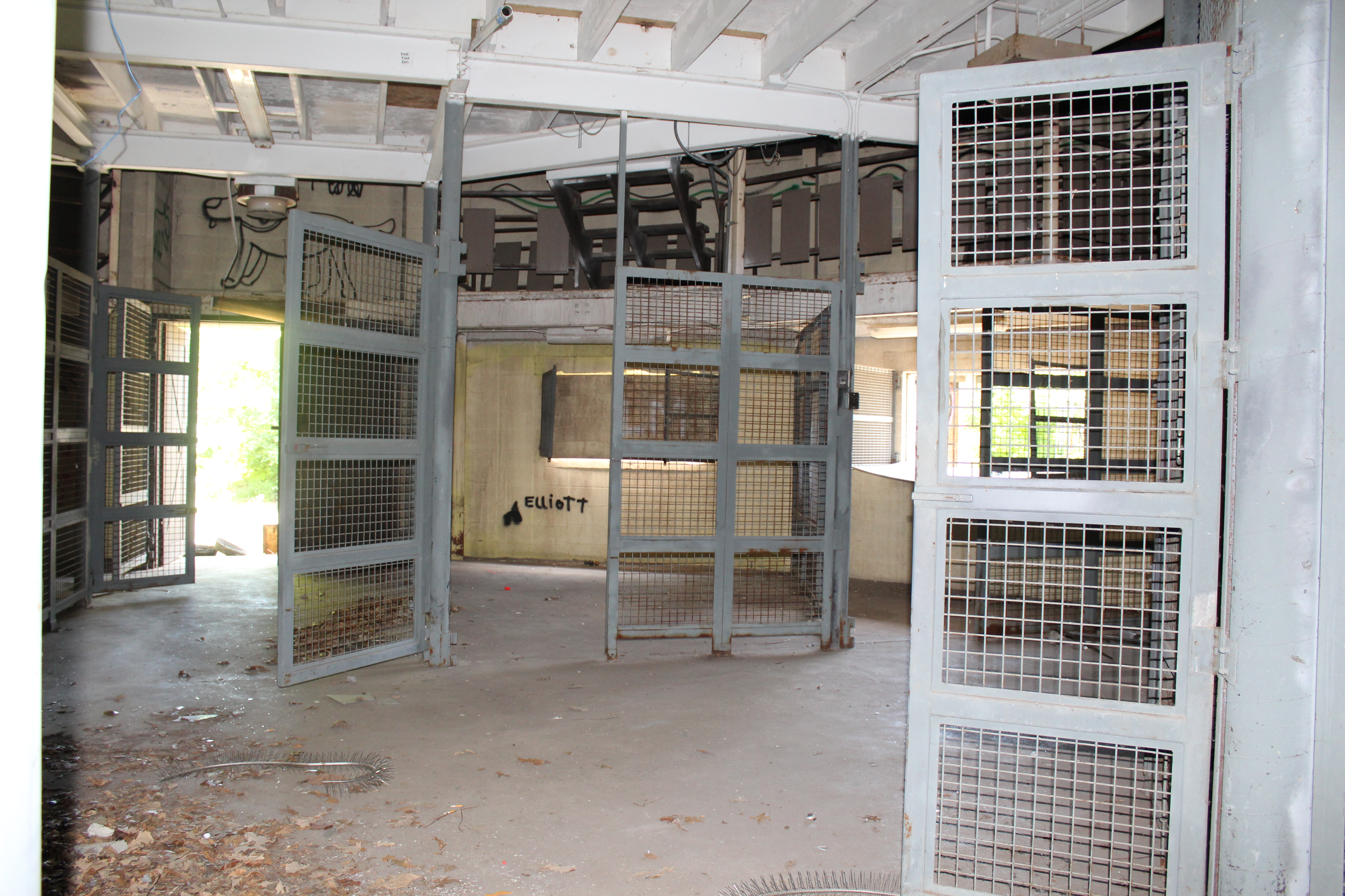 Abandoned cages inside building at Belle Isle Zoo