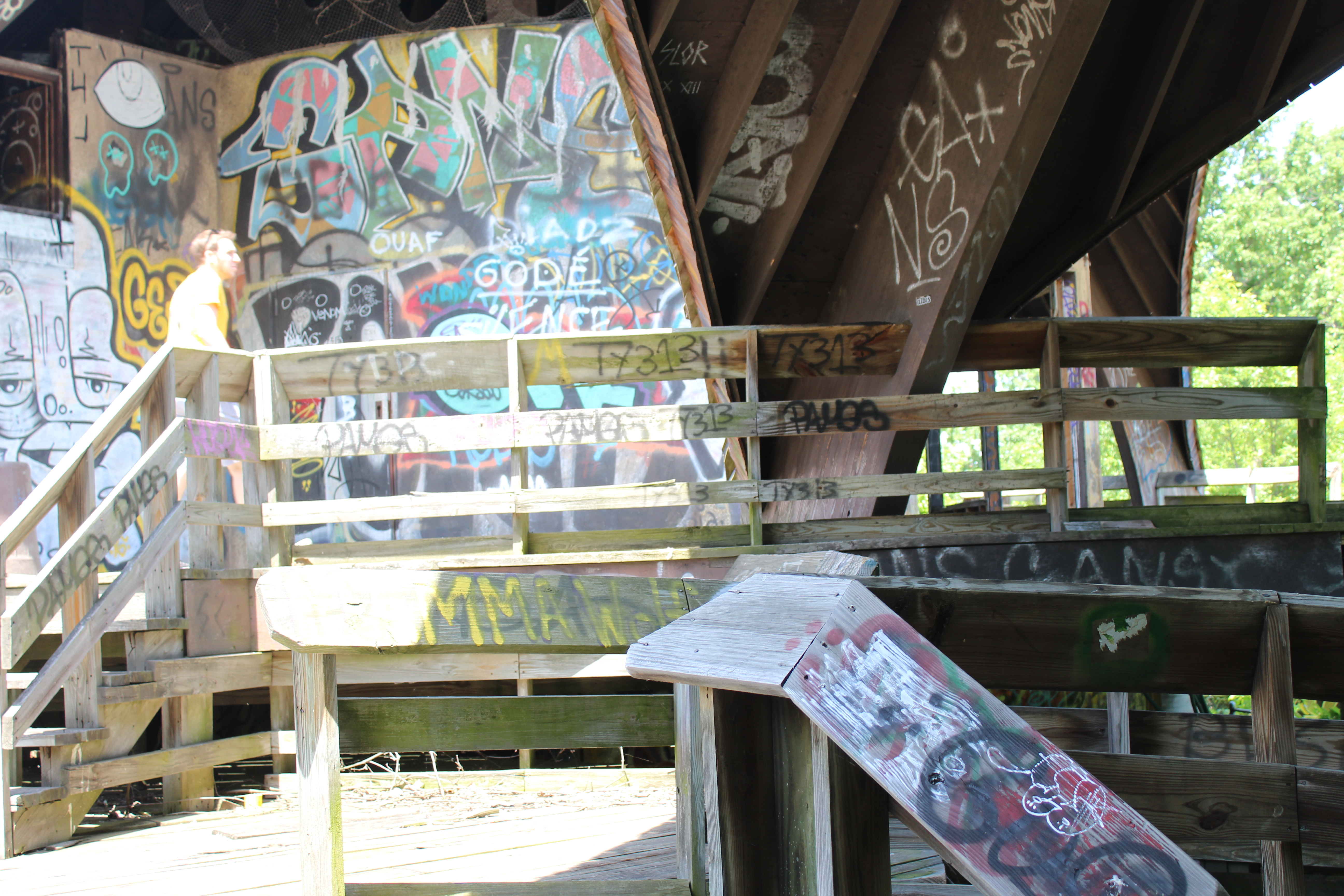 Wooden structure with staircase covered in graffiti at Belle Isle Zoo