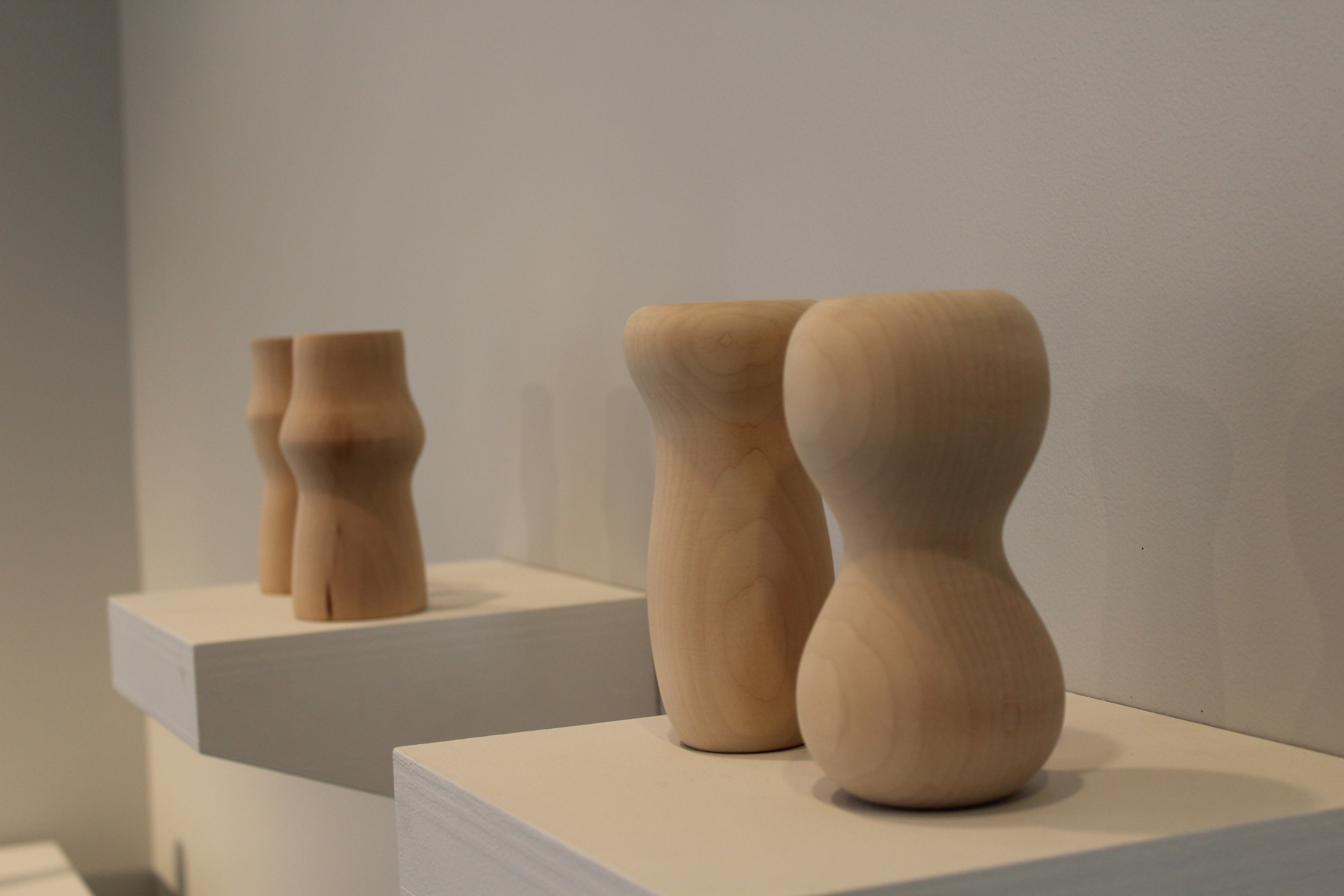 Wooden vases in pairs