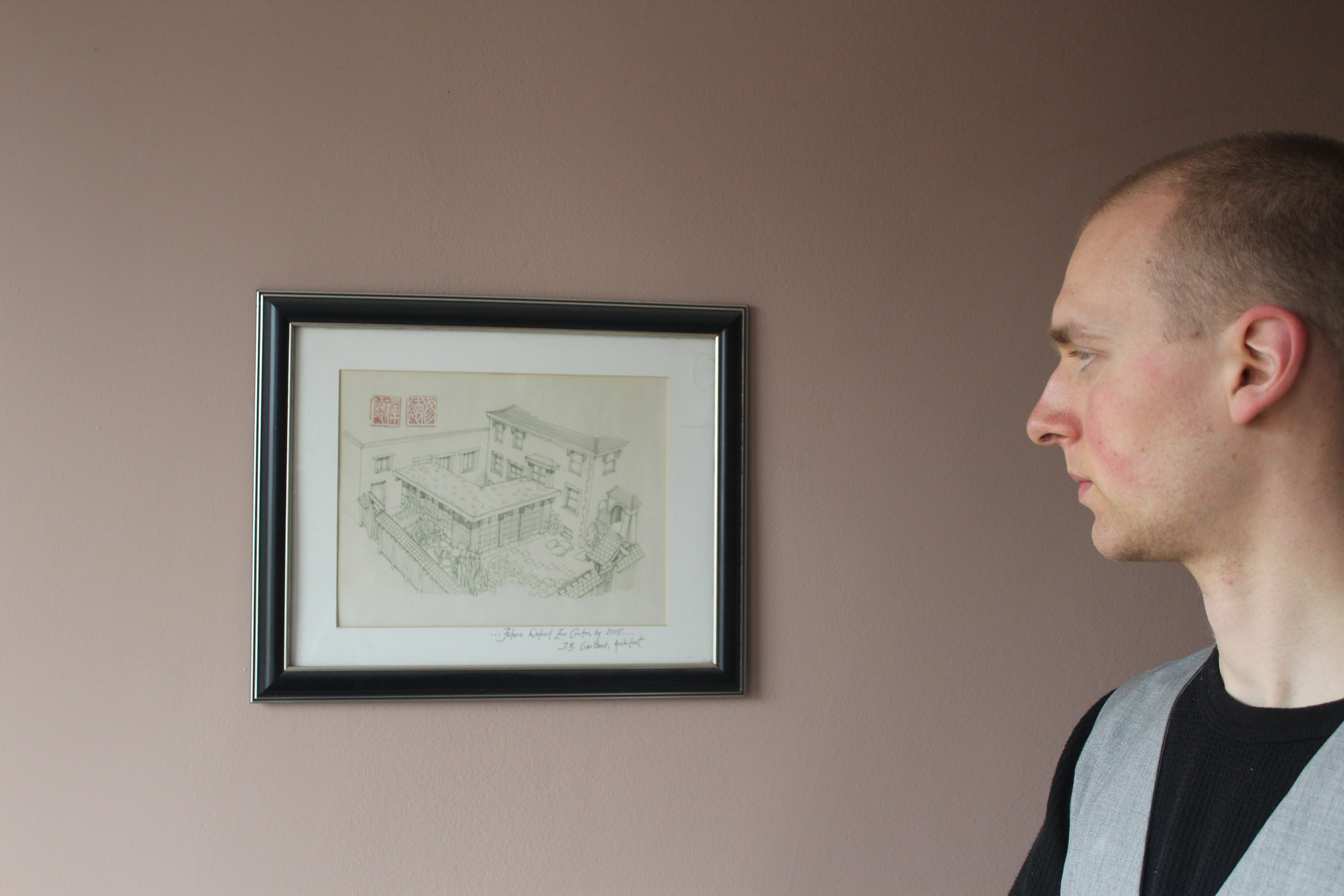 Sojong Silas Bruner looking at a drawing of the plans for the Detroit Zen Center