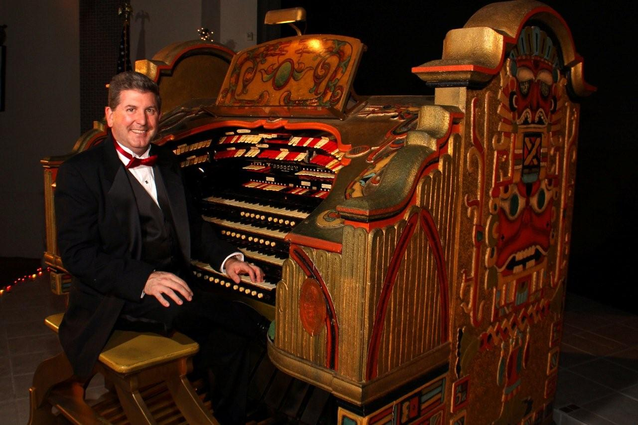 Photo of Lance Luce, president of The Detroit Organ Theater Society, with Senate's Wurlitzer Organ. Photo courtesy Lance Luce