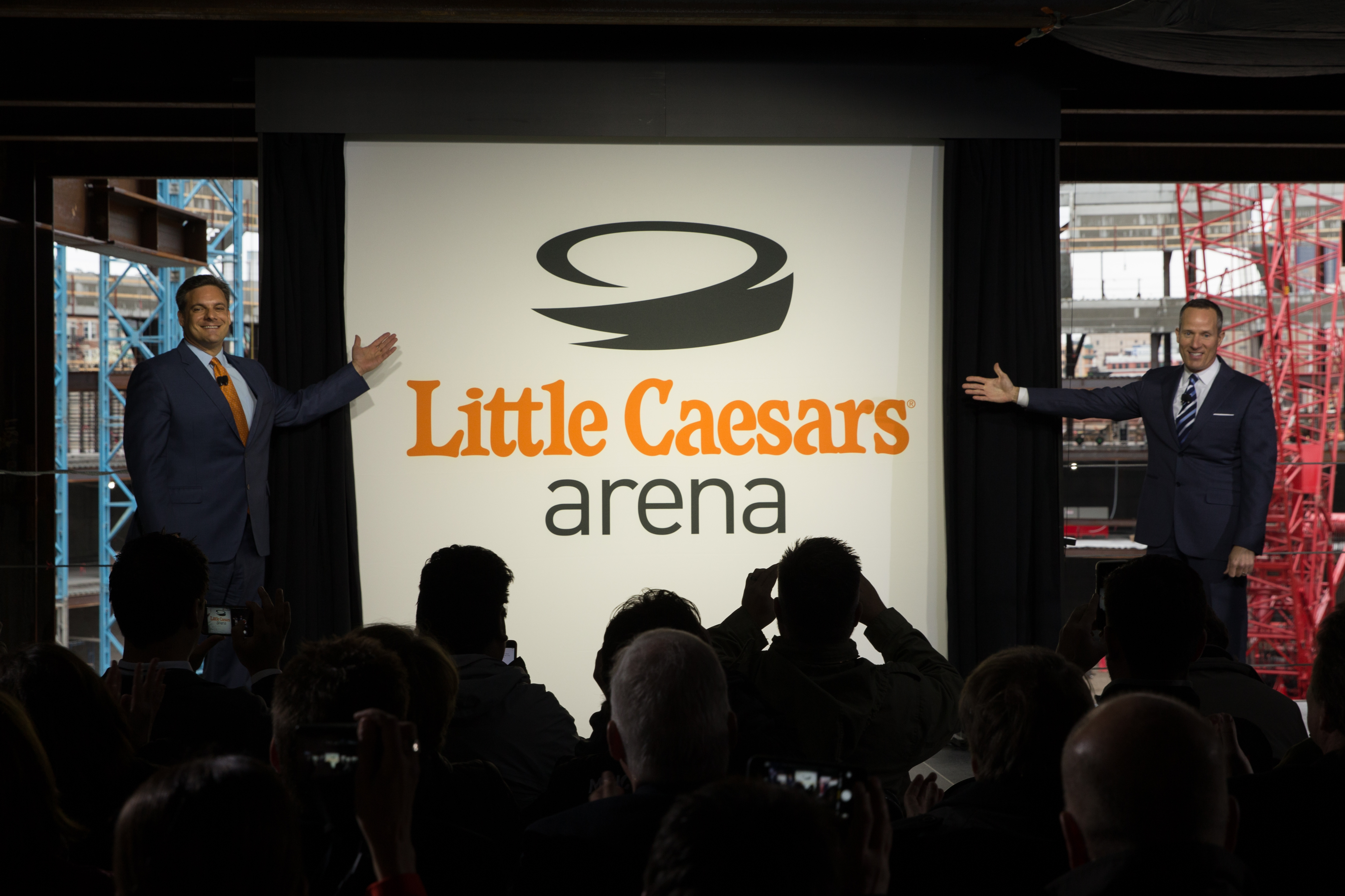 Photo of announcement of name of Little Caesars Arena before a small crowd.