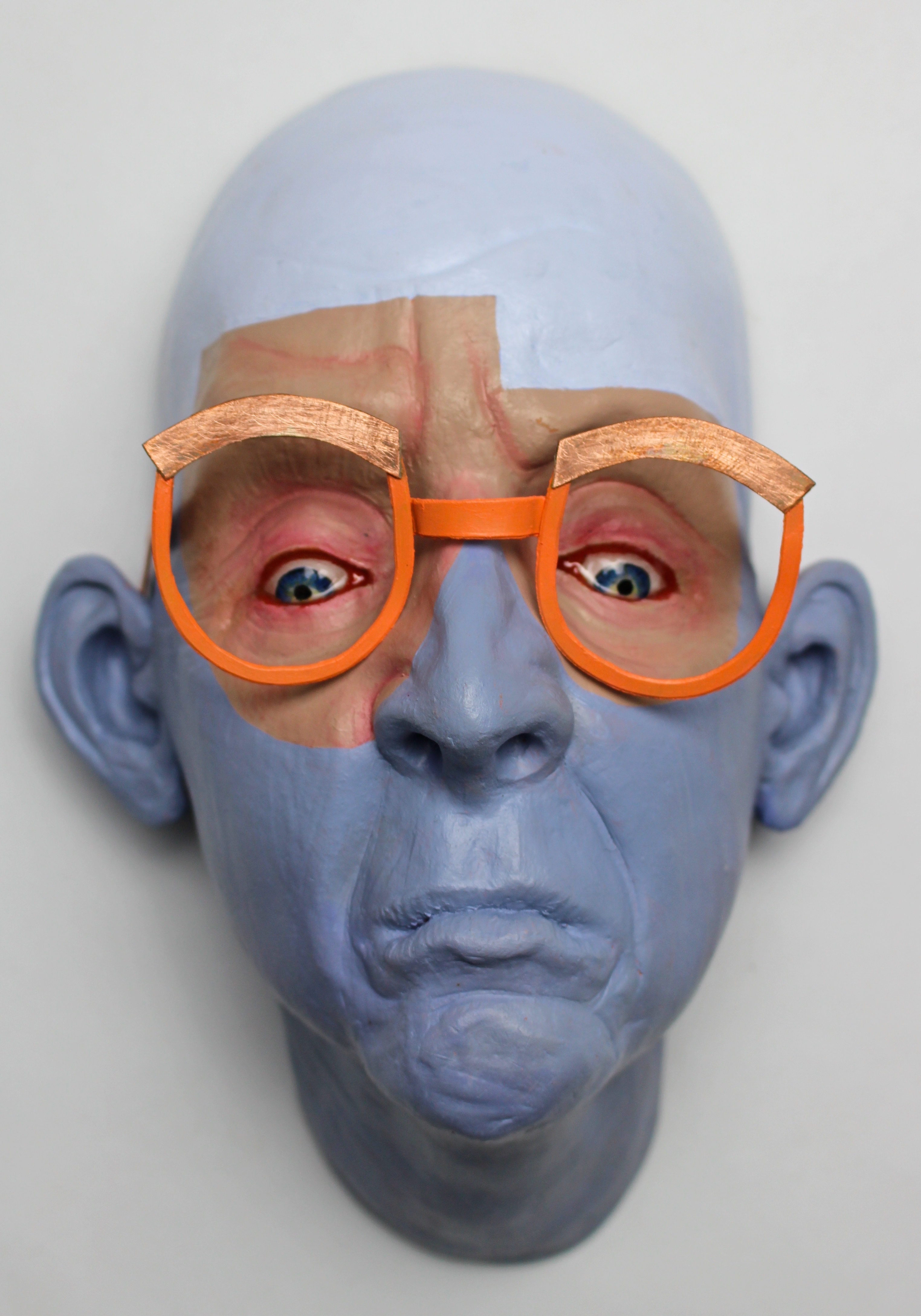 Luke Halling self-portrait mask bald and with orange glasses