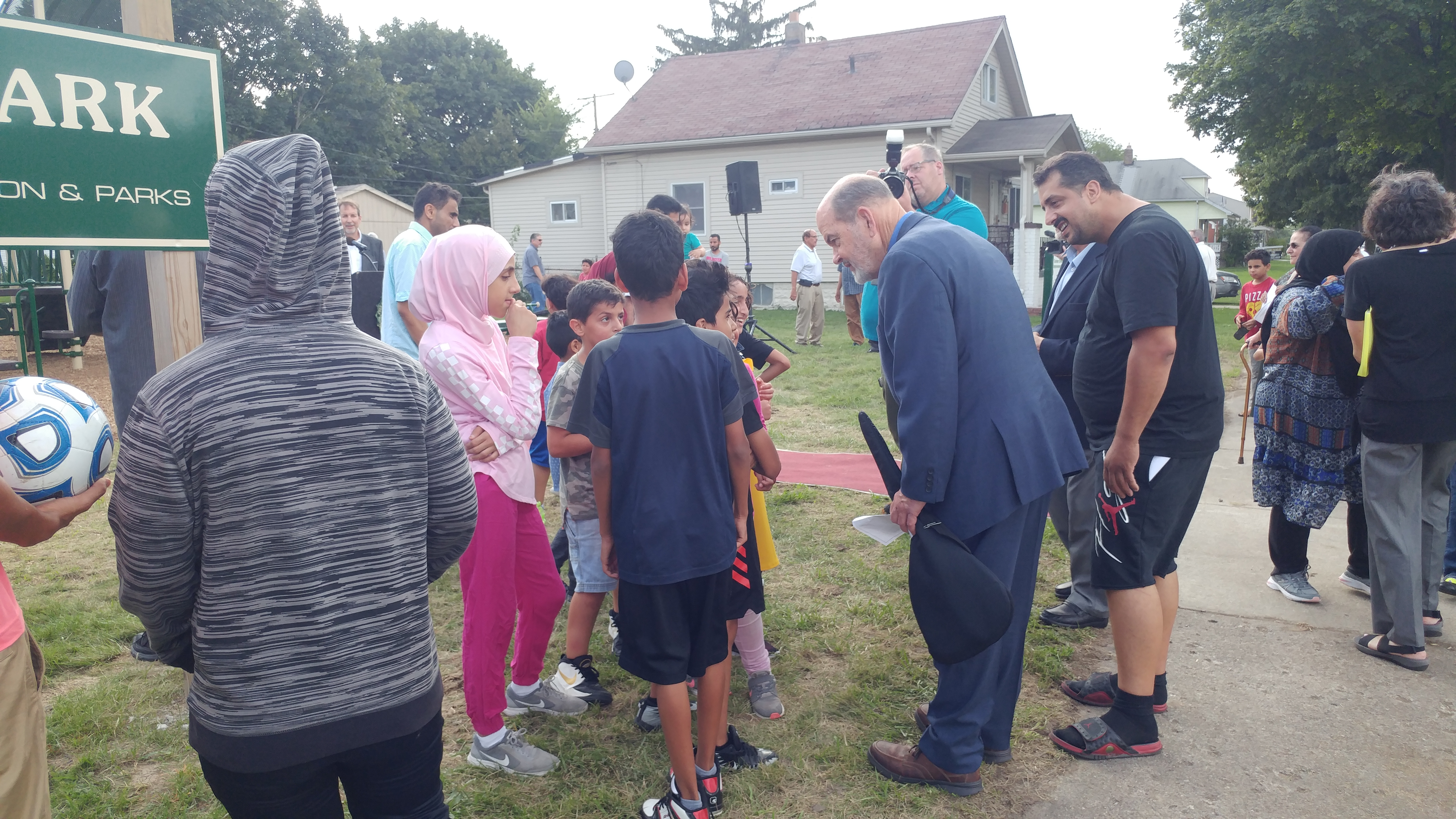 Image of Mayor John B. O'Reilly speaking with children