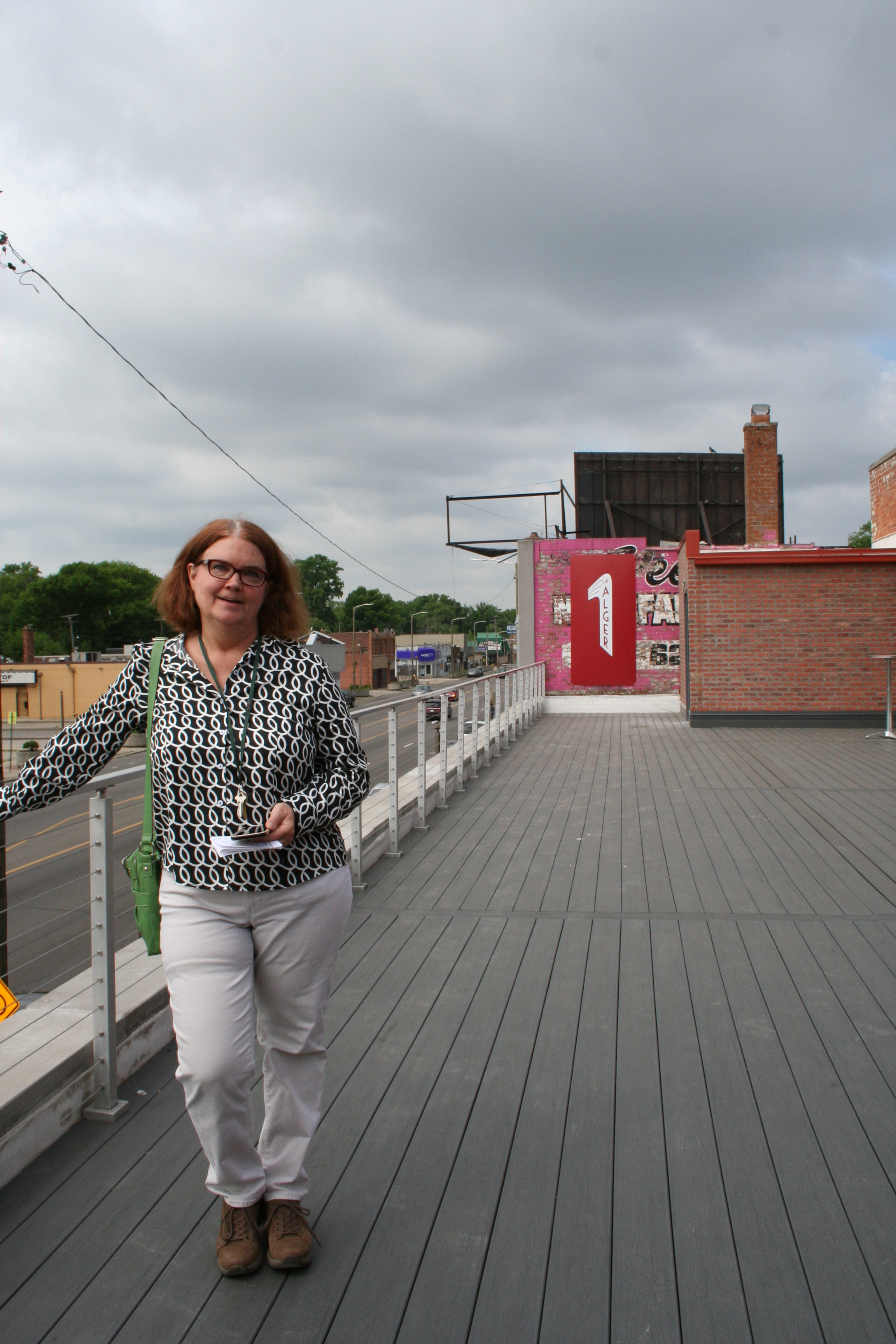 Photo of Alger Theater vice president, Melissa Bunker, on The Alger's rooftop patio. Photo by Mirror News Staff.