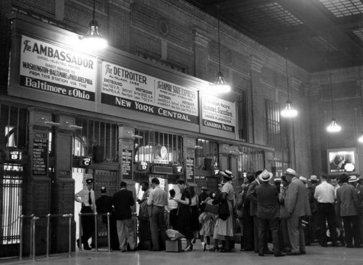 Passengers line up to board trains Photo courtesy of the Burton Historical Collection at The Detroit Public Library