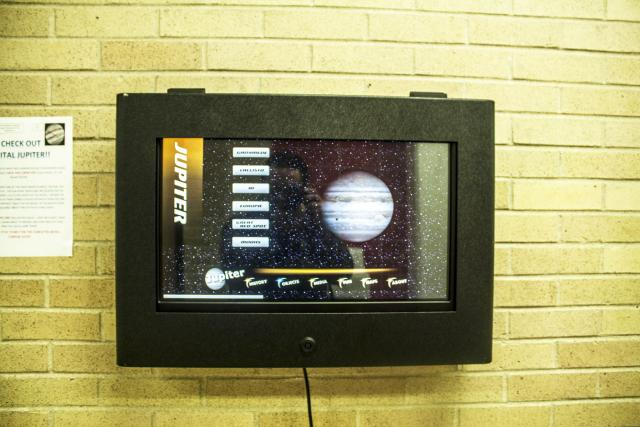 A screen displays the planet Jupiter and shows the planet and several options for details about the planet.