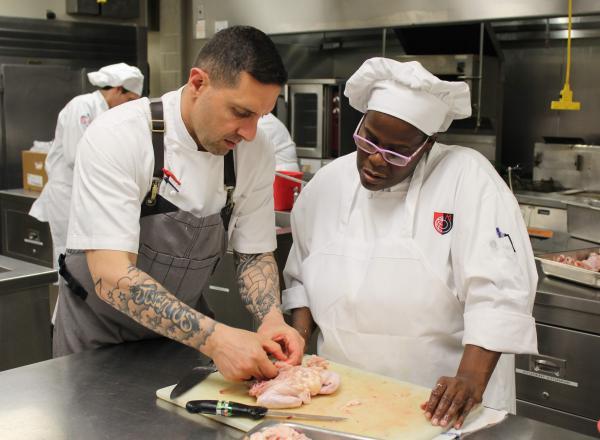 Photo of Chef Joseph Cosenza with student Priscilla Holmes