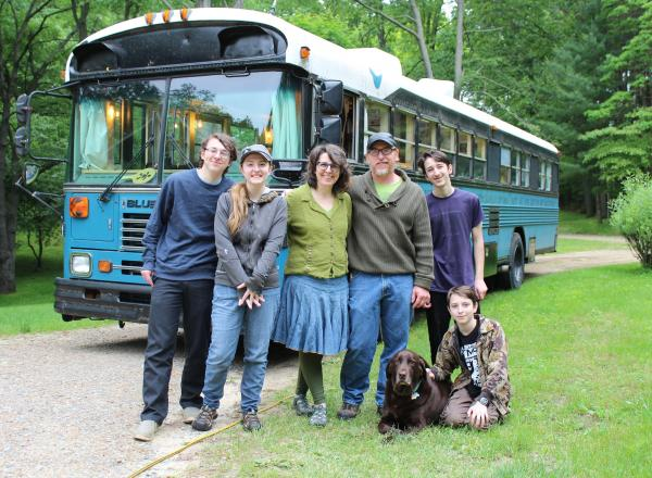 Photo of the Welch family standing in front of the bus home