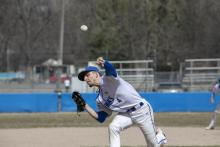 Photo of an HFC baseball player pitching