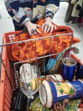Photo shows a cart full of thrift shop purchases