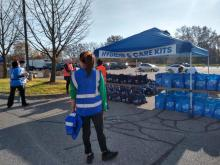 Photo of hygiene and care tent and volunteers at Day of Dignity event in Dearborn, Nov. 7, 2020