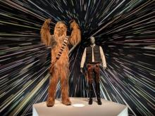 Photo showcasing Chewbacca and Han Solo costumes.