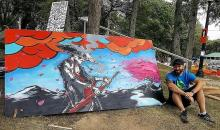 Photo of the artist Kyle Irving next to his painting masterless