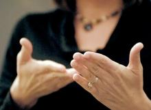 Close up of hands using American Sign Language